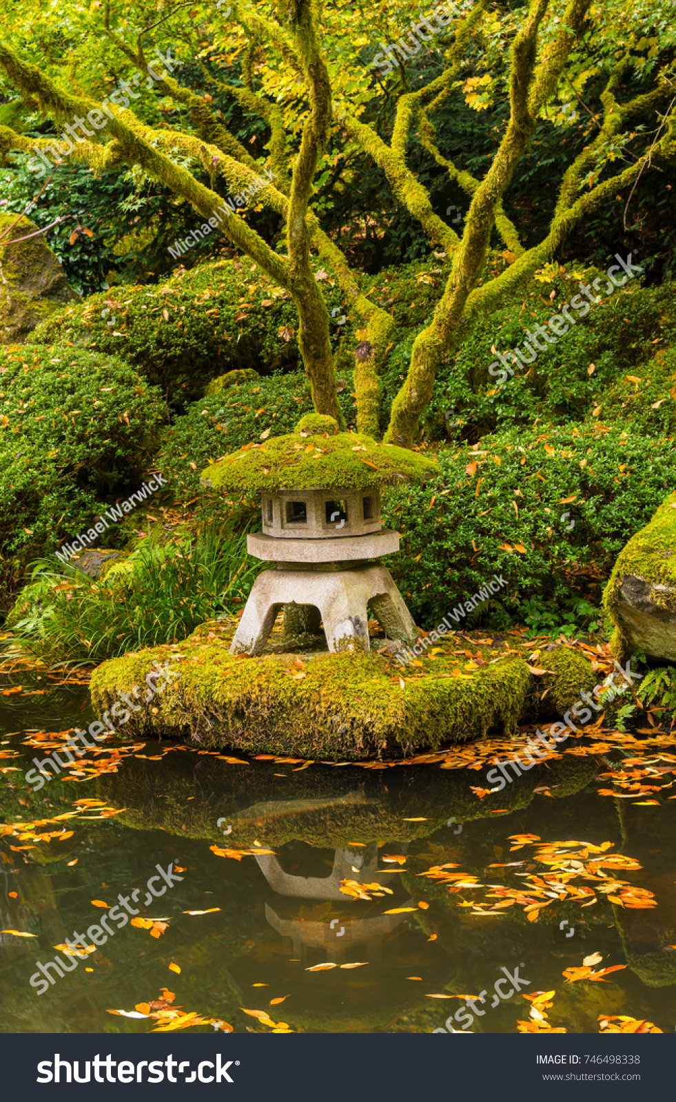 Japanese Zen Garden And Water Pond With Autumn Fallen Leaves