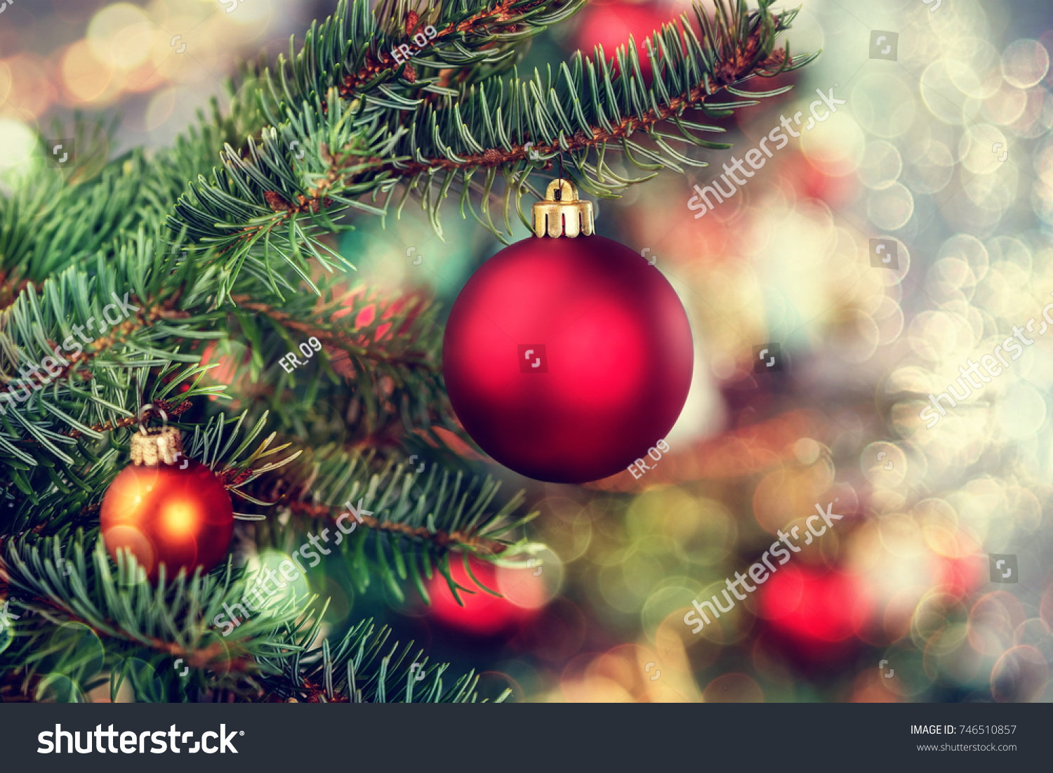 Christmas background - baubles and branch of spruce tree #746510857
