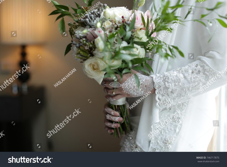 Bride white henna fresh flower hand stock photo edit now 746717875 bride white henna with fresh flower hand bouquet izmirmasajfo
