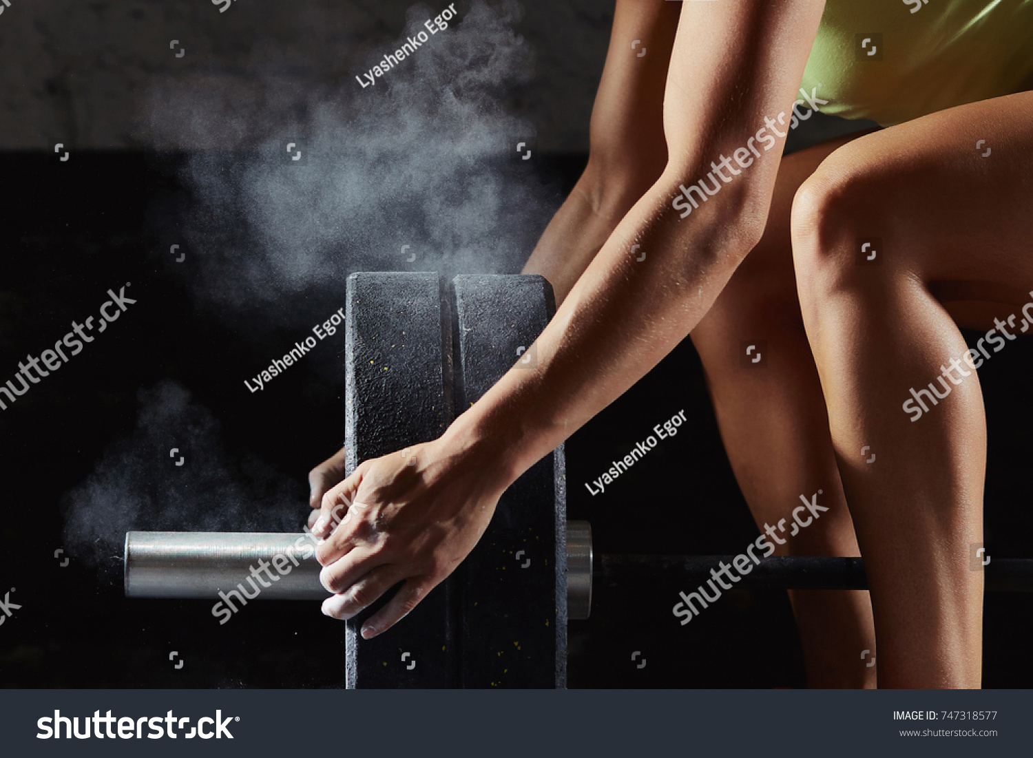 Shot of a female athlete preparing barbell for weightlifting at the gym  magnesia protection powerlifting crossfit