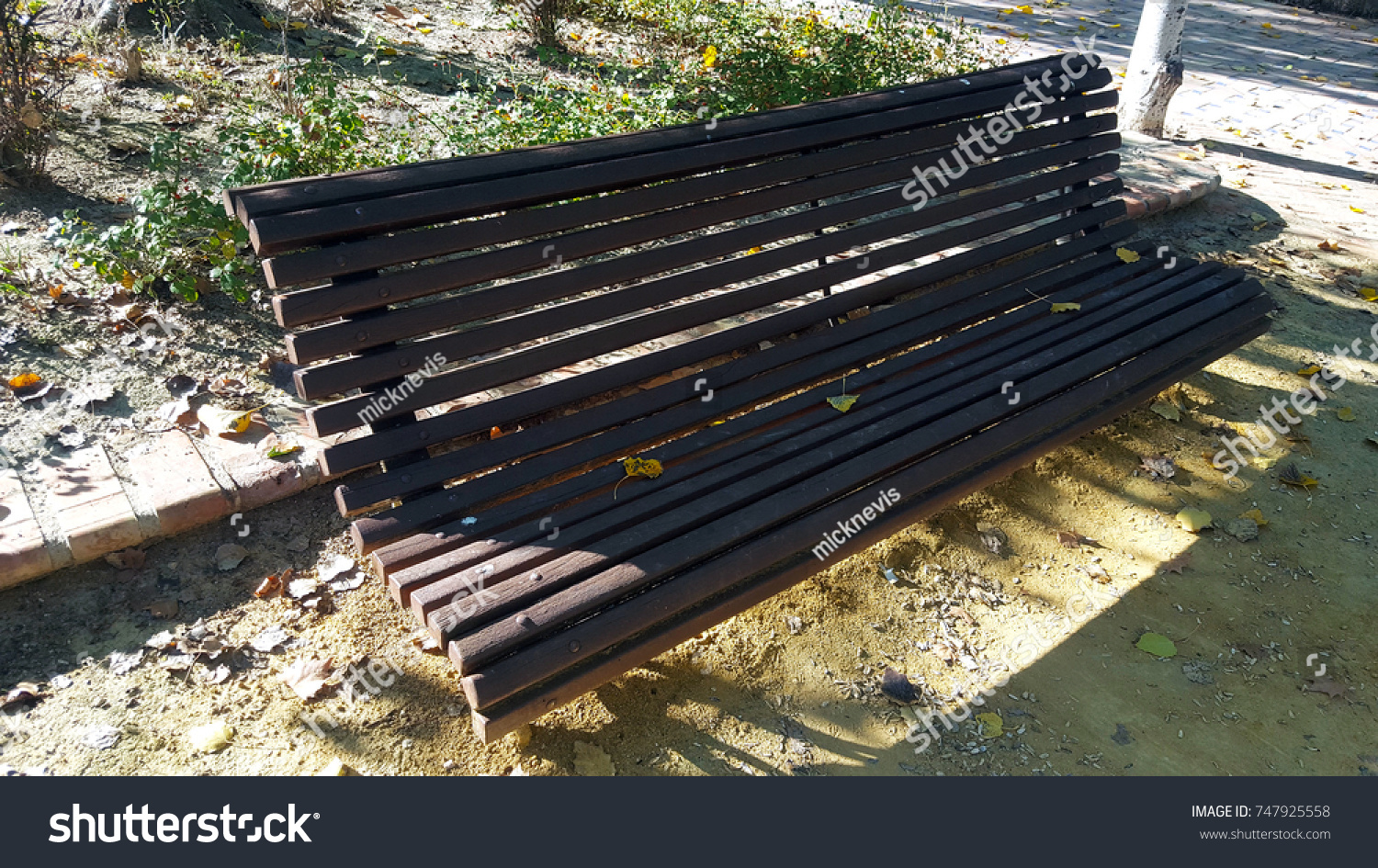 Metal Wood Park Bench Autumn Leaves Stock Photo Edit Now 747925558