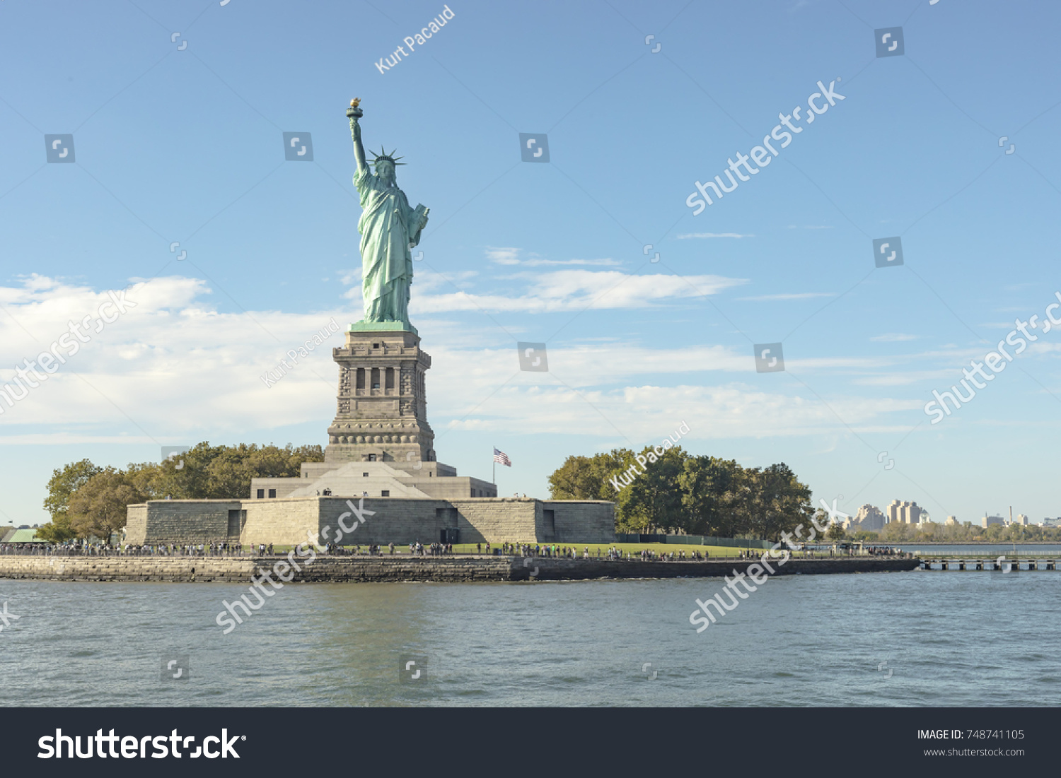 of sky a photos sunny liberty images in and clear tickets blue photo day dark statue on stock pedestal