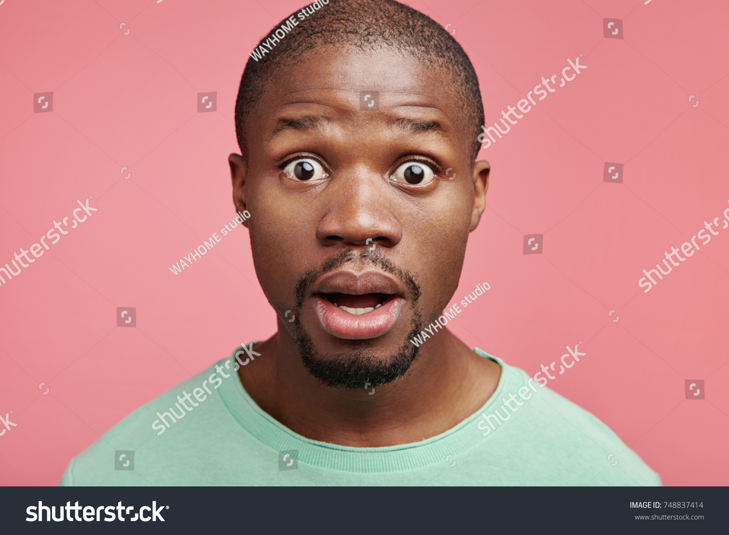 Stressful Bug Eyed Dark Skinned Man Stock Photo Edit Now 748837414
