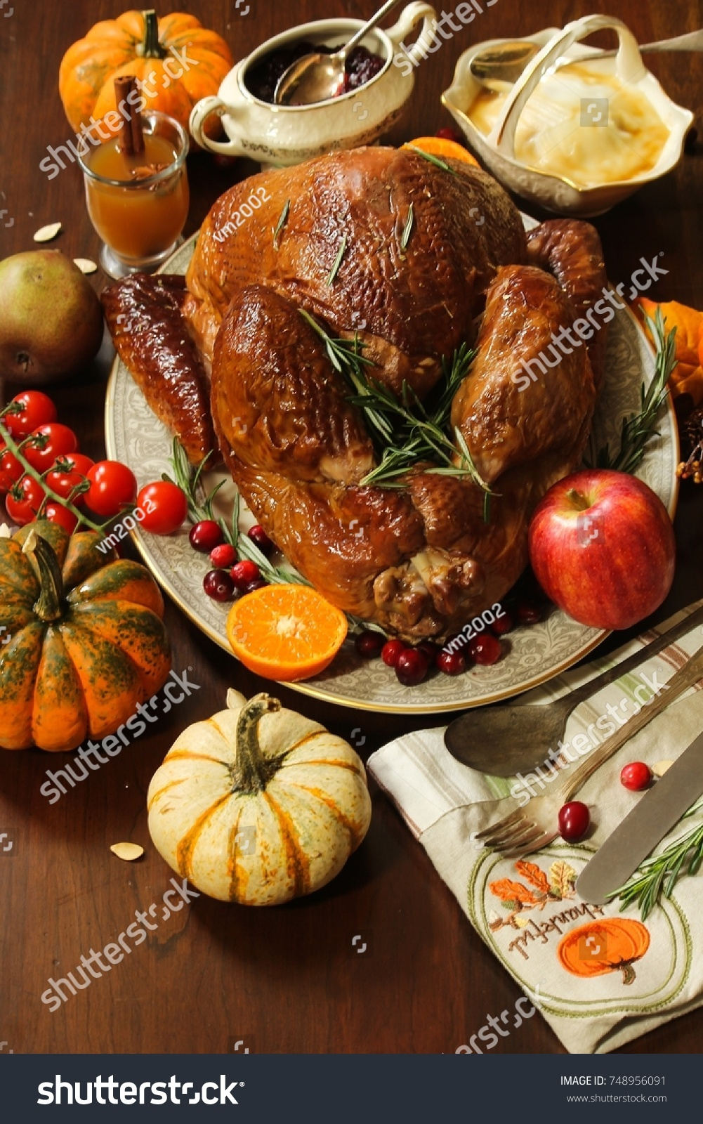 Thanksgiving Dinner Table setting with roasted Turkey gravy cranberry sauce and fall vegetables & Thanksgiving Dinner Table Setting Roasted Turkey Stock Photo (Safe ...
