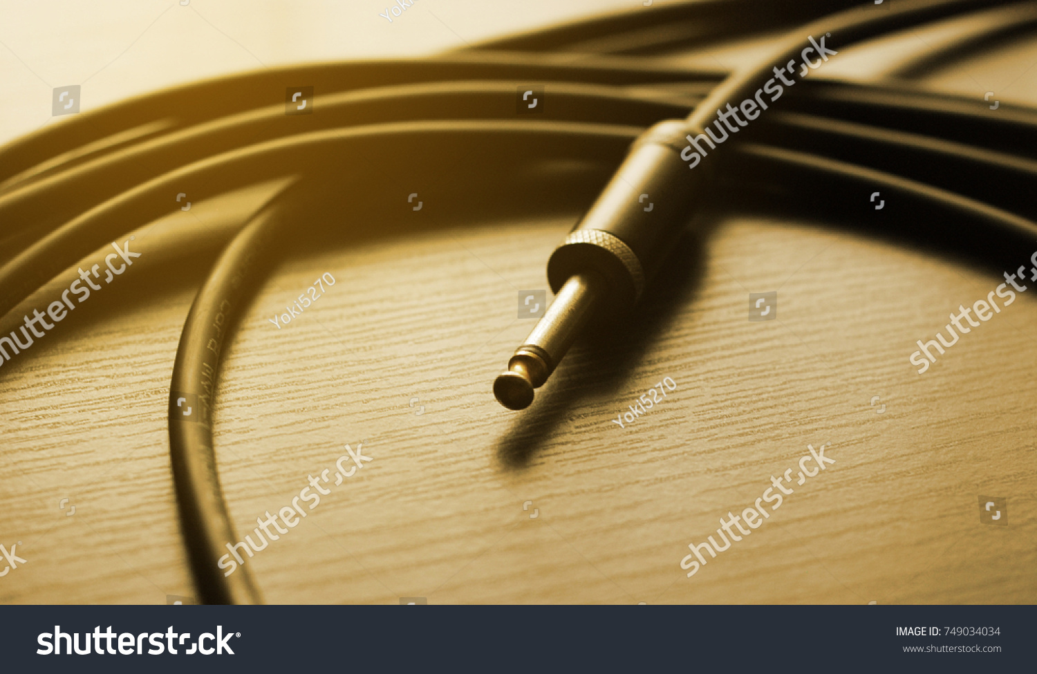 Guitar Cable Audio Jack On Dark Stock Photo Edit Now 749034034 Wiring Wood Background Warm Tone