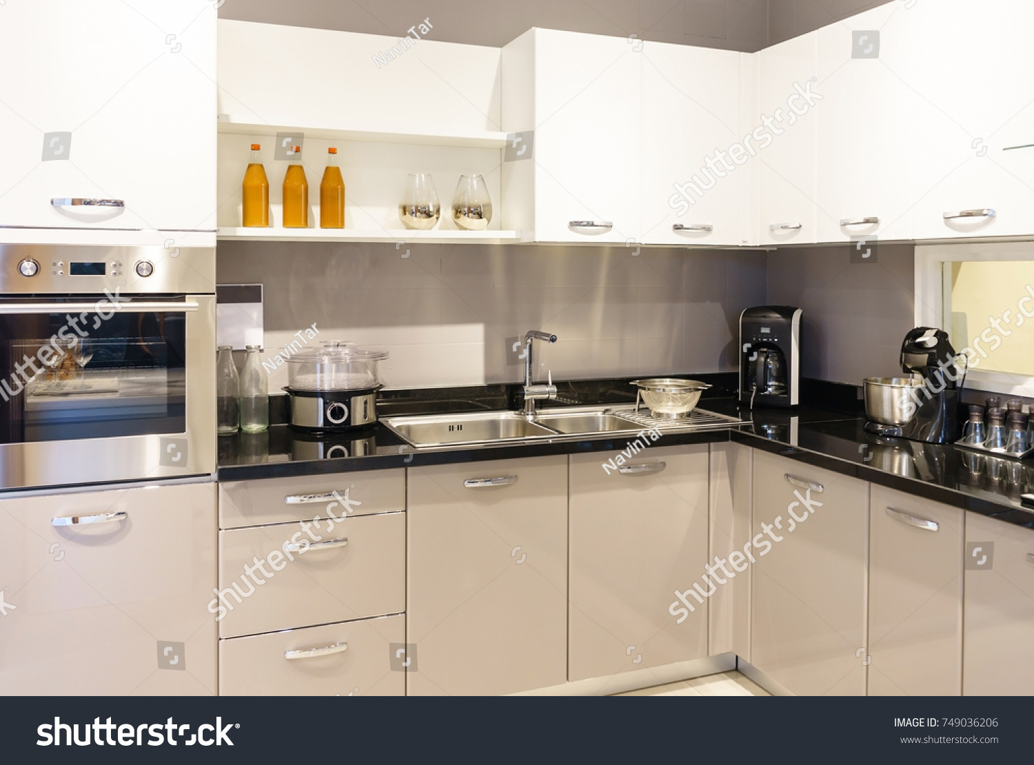 contemporary kitchen furniture detail. Modern Kitchen Furniture With Contemporary Kitchenware Like Hood, Black Induction Stove And Oven In House Detail I