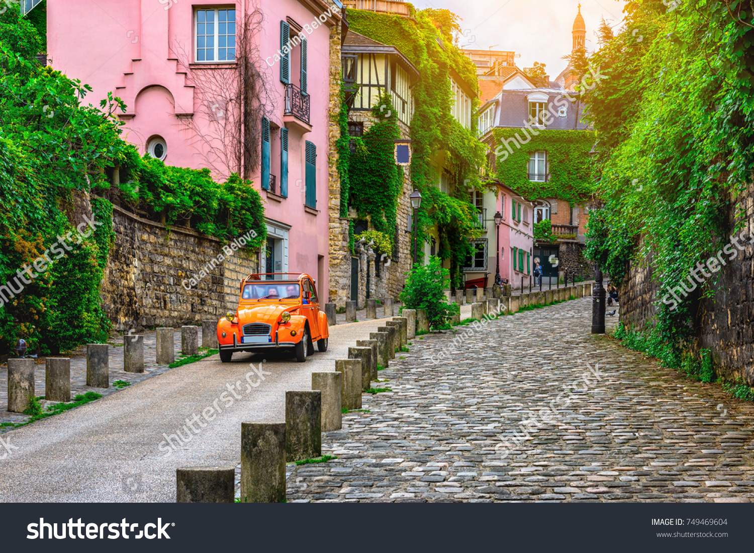 View of old street in quarter Montmartre in Paris, France. Cozy cityscape of Paris. Architecture and landmarks of Paris.  #749469604