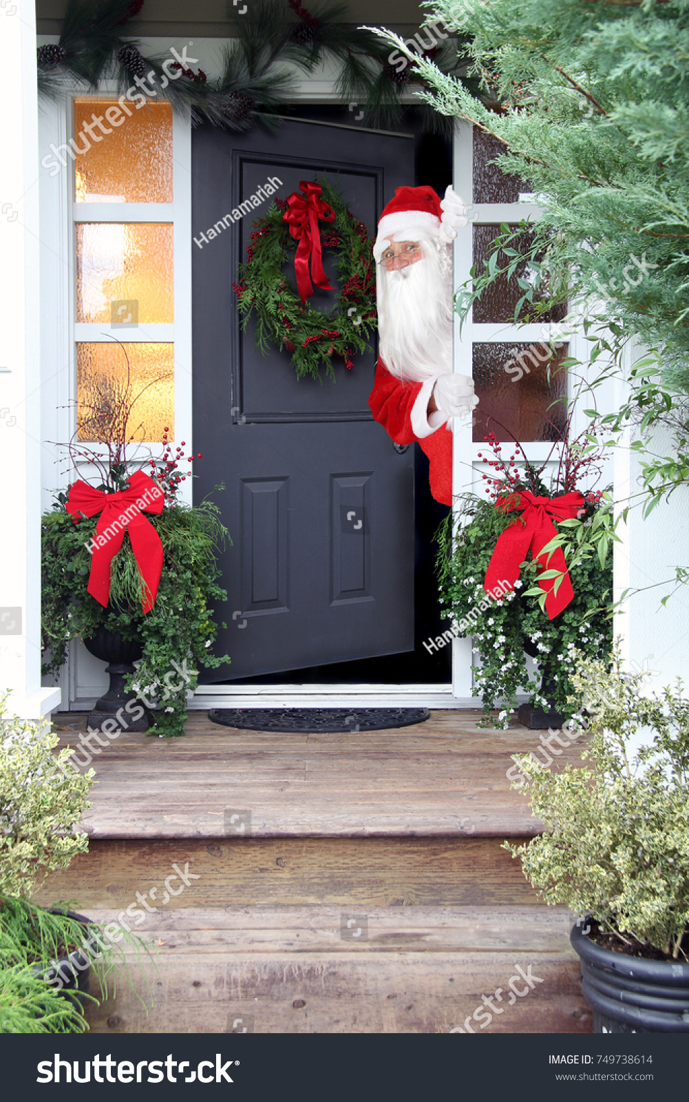 Santa Claus Looking Out Front Door Stock Photo 749738614 ...