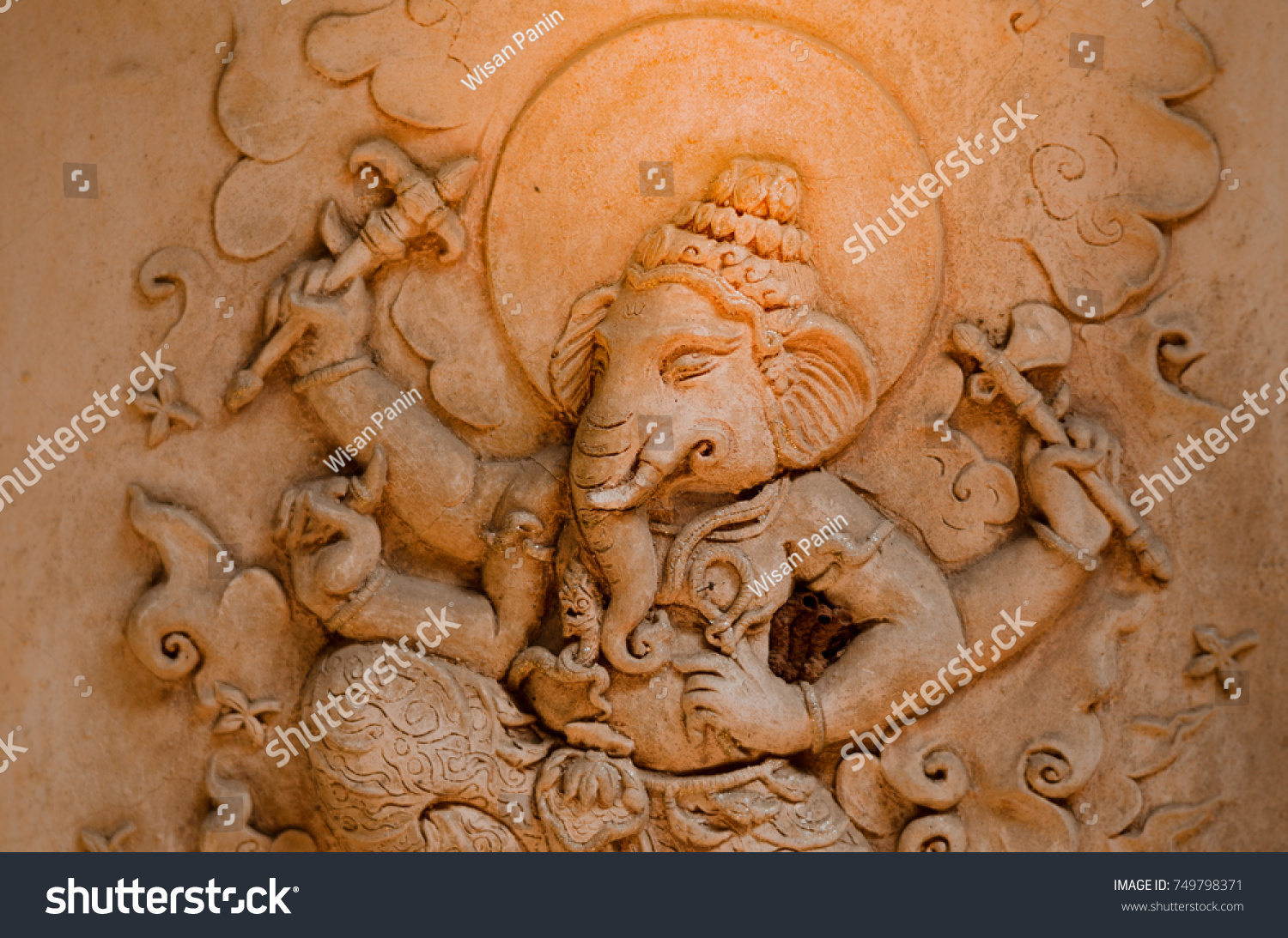 wall baked clay statue ganesh stock photo (100% legal protection