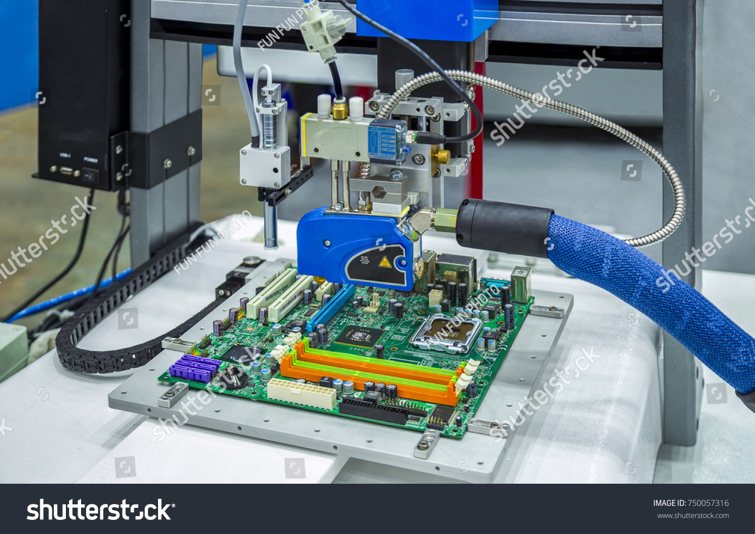 Automatic Hot Melt Glue Applicator Adhesive Stock Photo Edit Now Circuit Board Printed Control For Embroidery Machine And Dispensing Gun With Auger Valve Solder Onto A