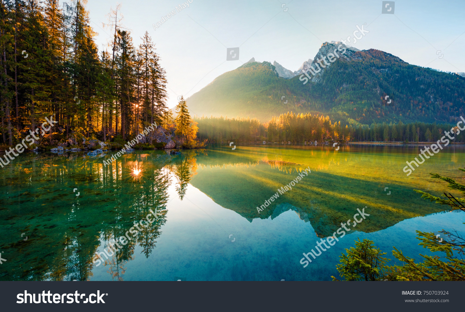 Wonderful autumn sunrise of Hintersee lake. Amazing morning view of Bavarian Alps on the Austrian border, Germany, Europe. Beauty of nature concept background. #750703924