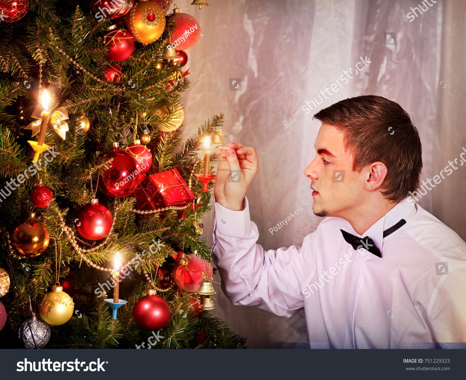 Man Dressing Christmas Tree Expectation Holiday Stock