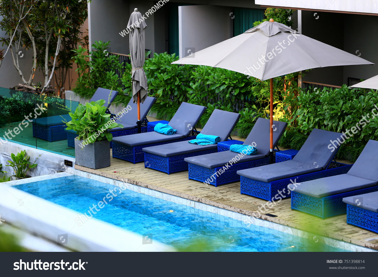 Swimming Pool With Relaxing Seats.pool Bed Near Swimming Pool .selective  Focus.