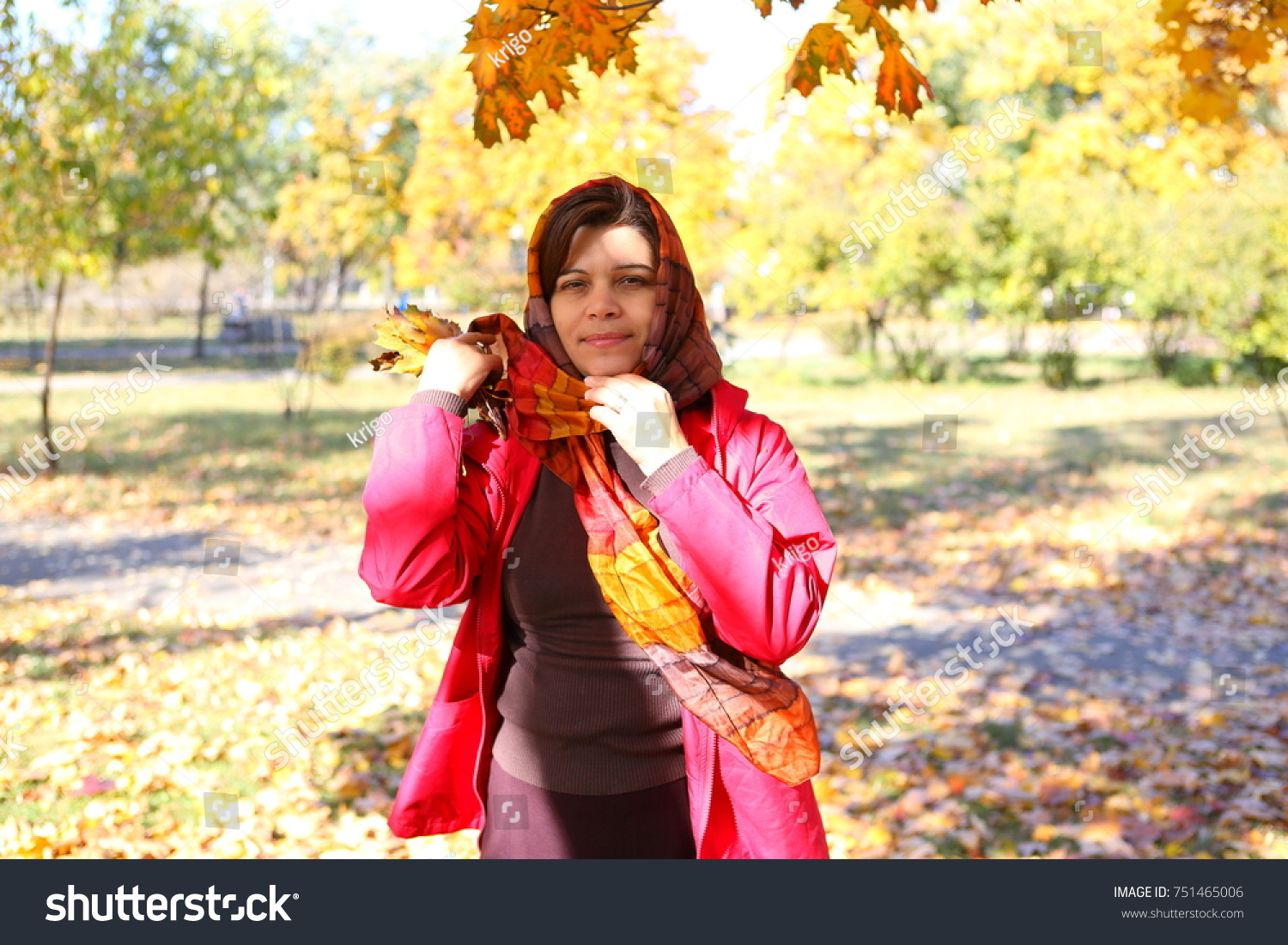 Woman in autumn park #751465006
