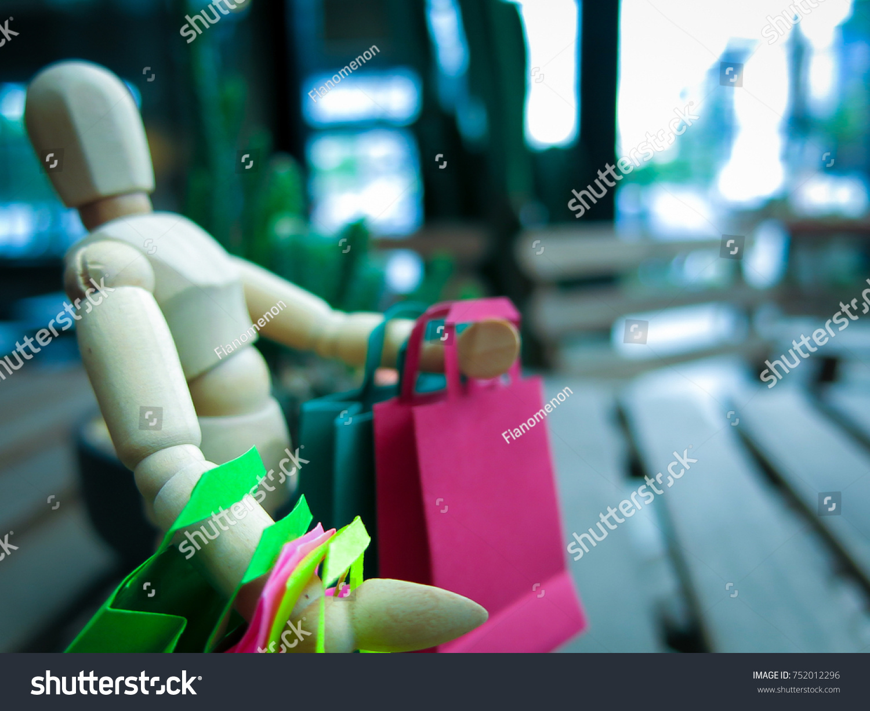 Shopping greeting season imaginary world shopaholics stock photo shopping for greeting season in imaginary world with shopaholics wood mannequin miniature robot kristyandbryce Image collections