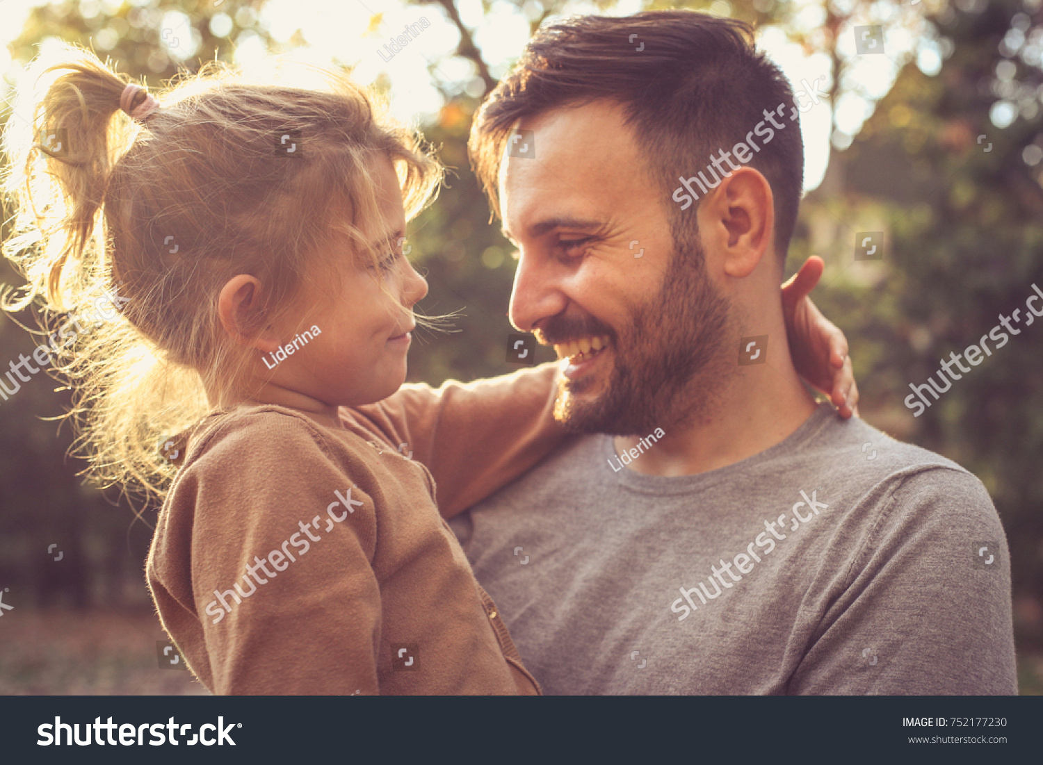 Father and daughter share love.  #752177230