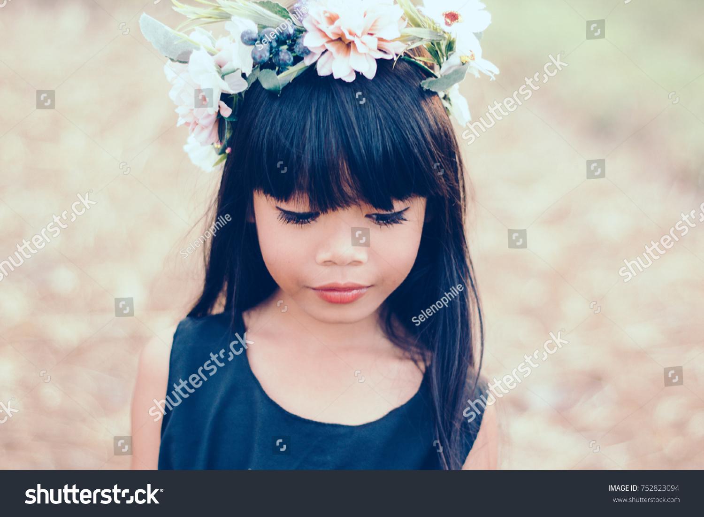 Little kid girl flower crown retro stock photo safe to use a little kid girl with flower crown retro vintage filter effect izmirmasajfo