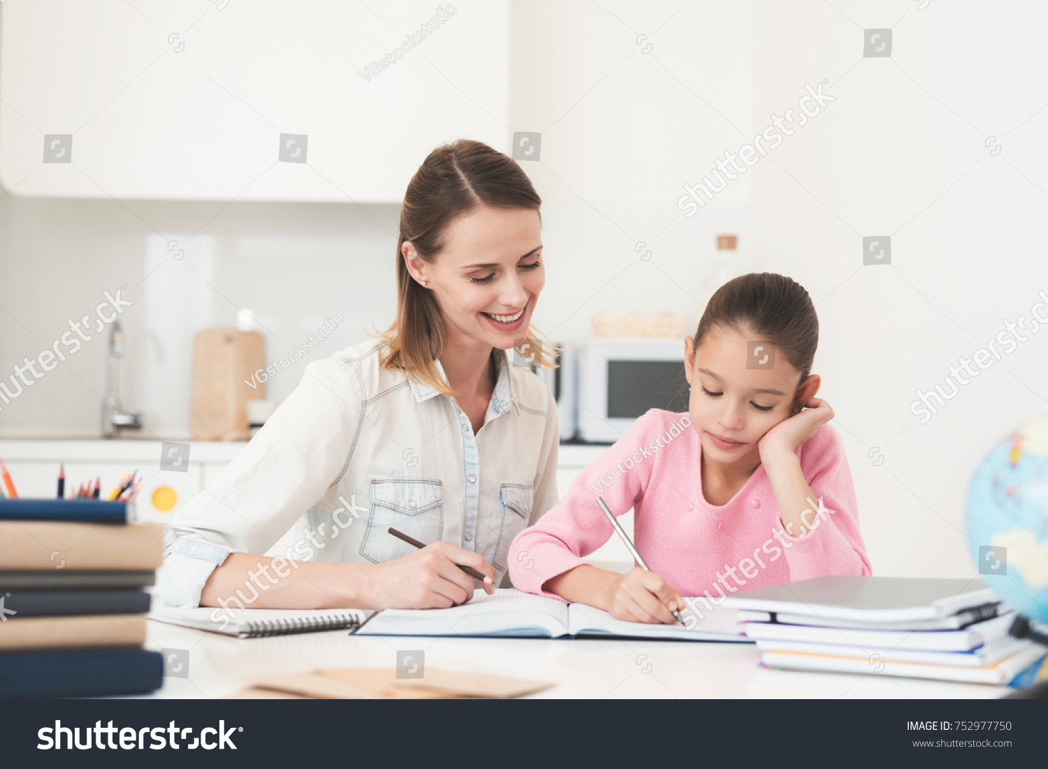 Mom Helps My Daughter Do Her Stock Photo (Royalty Free) 752977750 ...