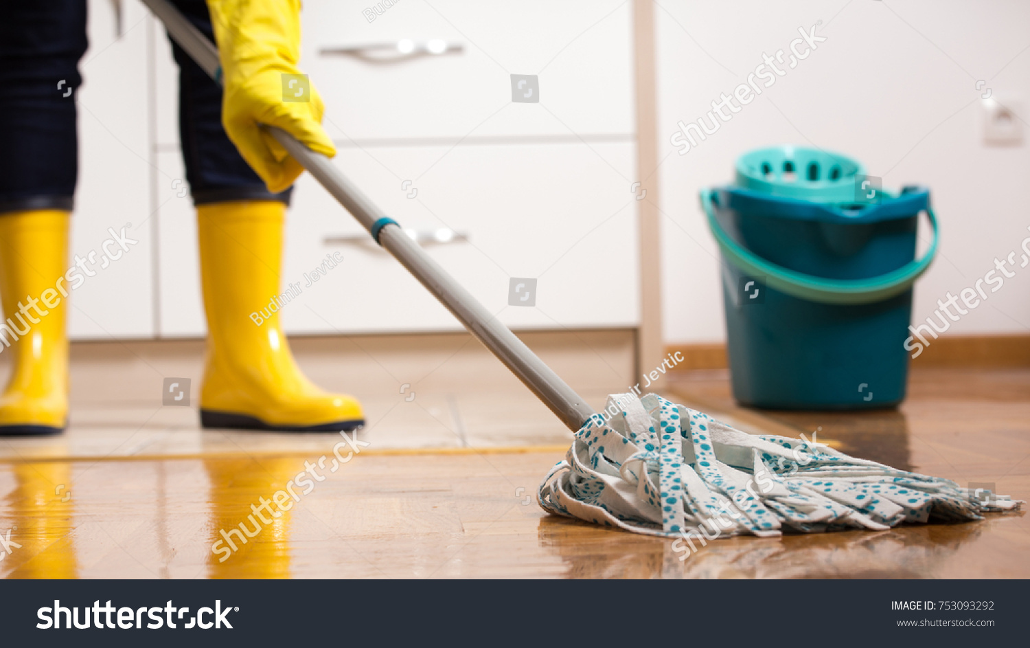 Maid gumboots mopping tiled floor kitchen stock photo royalty free maid in gumboots mopping tiled floor in kitchen housekeeping and home hygiene concept dailygadgetfo Image collections