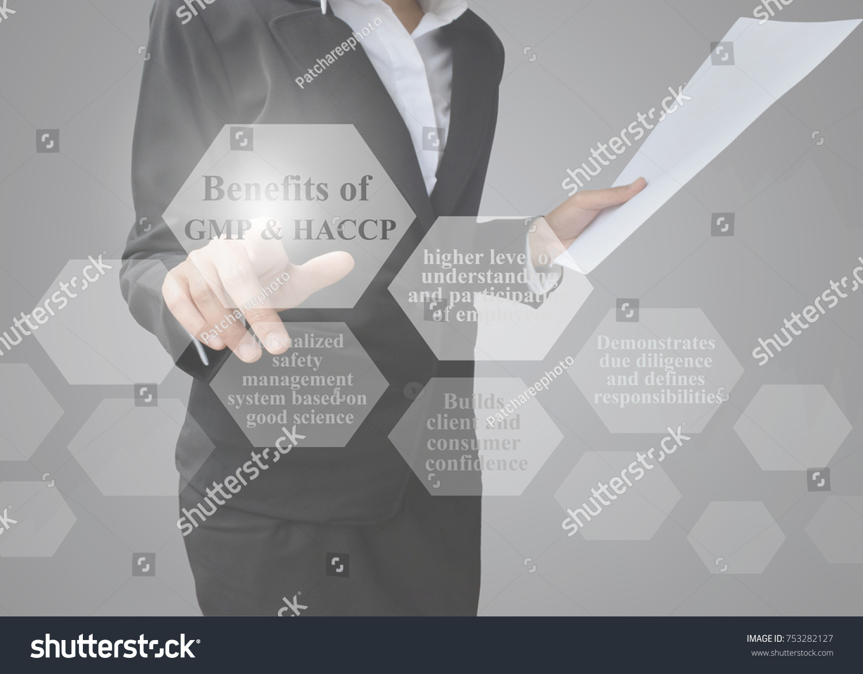 Businesswoman Showing Presentation Benefits GMP HACCP Stock