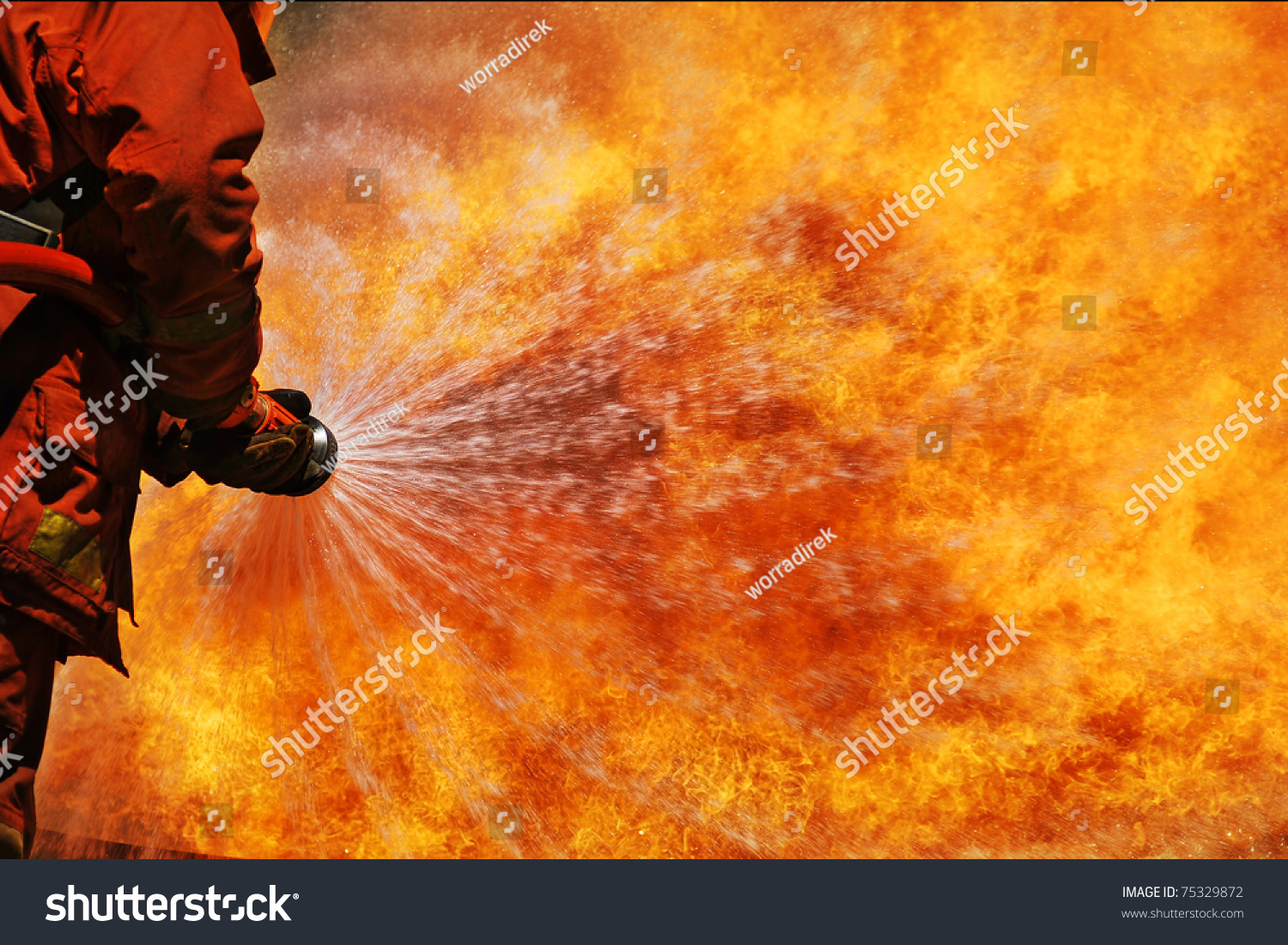 Firefighter Fighting Fire During Training Stock Photo 75329872 ...