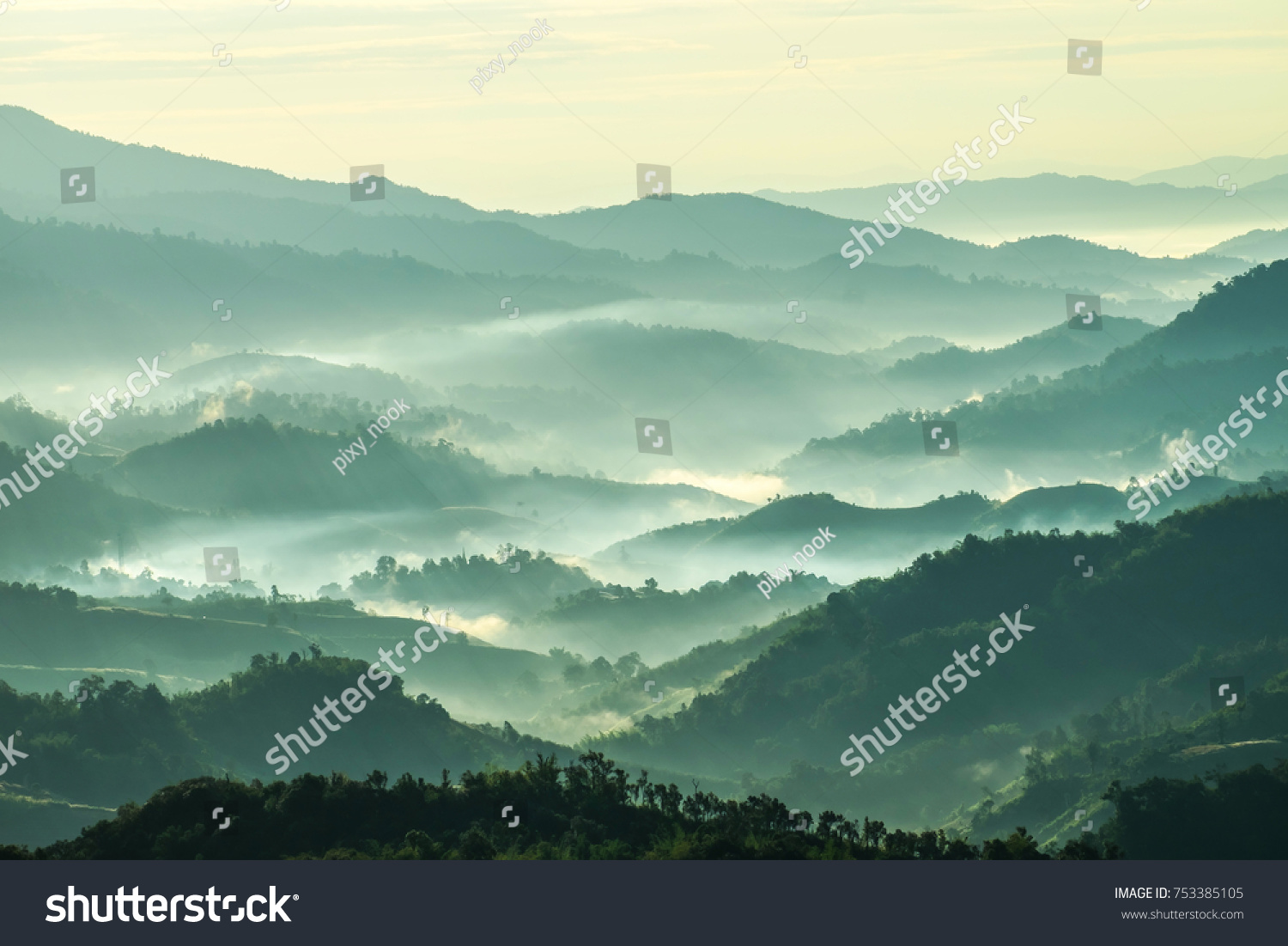Beautiful Landscape of mountain layer in morning sun ray and winter fog at  Doi Hua Mae Kham,  Mae Salong Nai, Chiangrai, Thailand #753385105