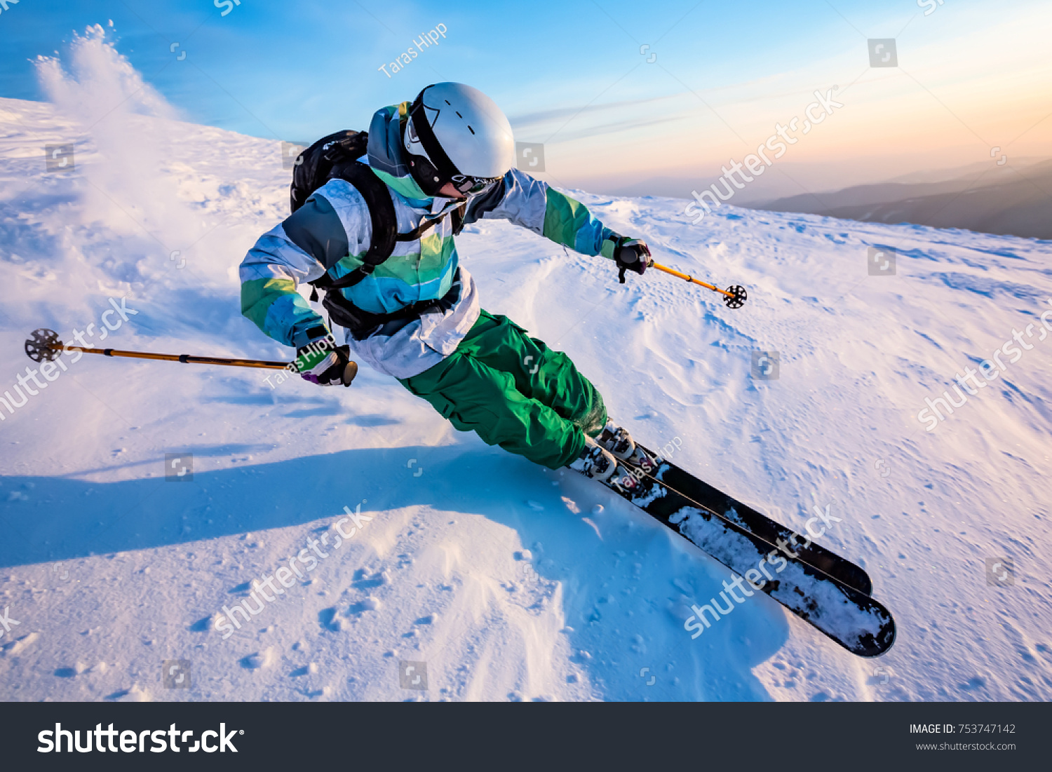 good skiing in the snowy mountains, Carpathians, Ukraine, nice winter day #753747142