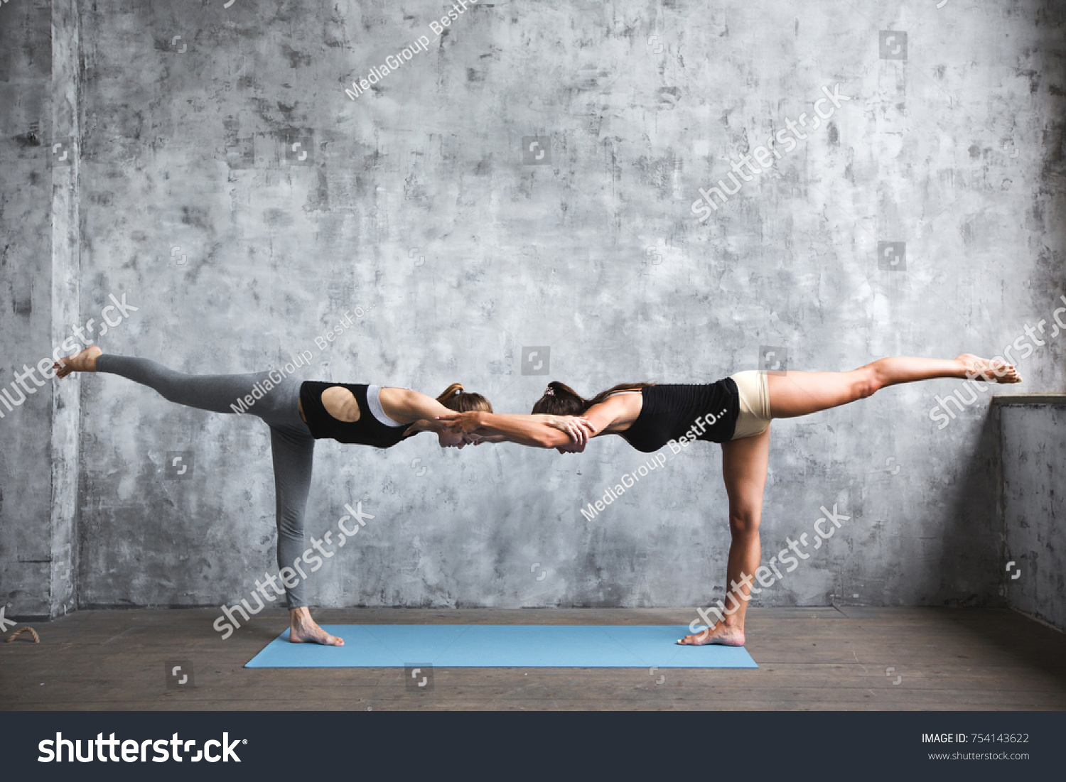Yoga Two Young Women Practicing Yoga Stock Photo Edit Now 754143622
