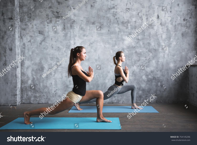 Pair Sporty Yoga Women Doing Exercise On Gray Stylish Background Couple