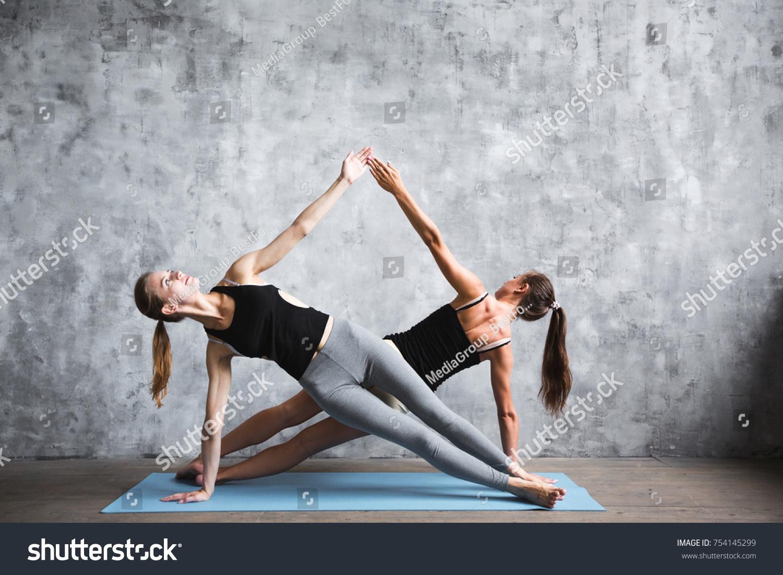 Pair Sporty Yoga Women Doing Exercise On Gray Stylish Background Couple Pose