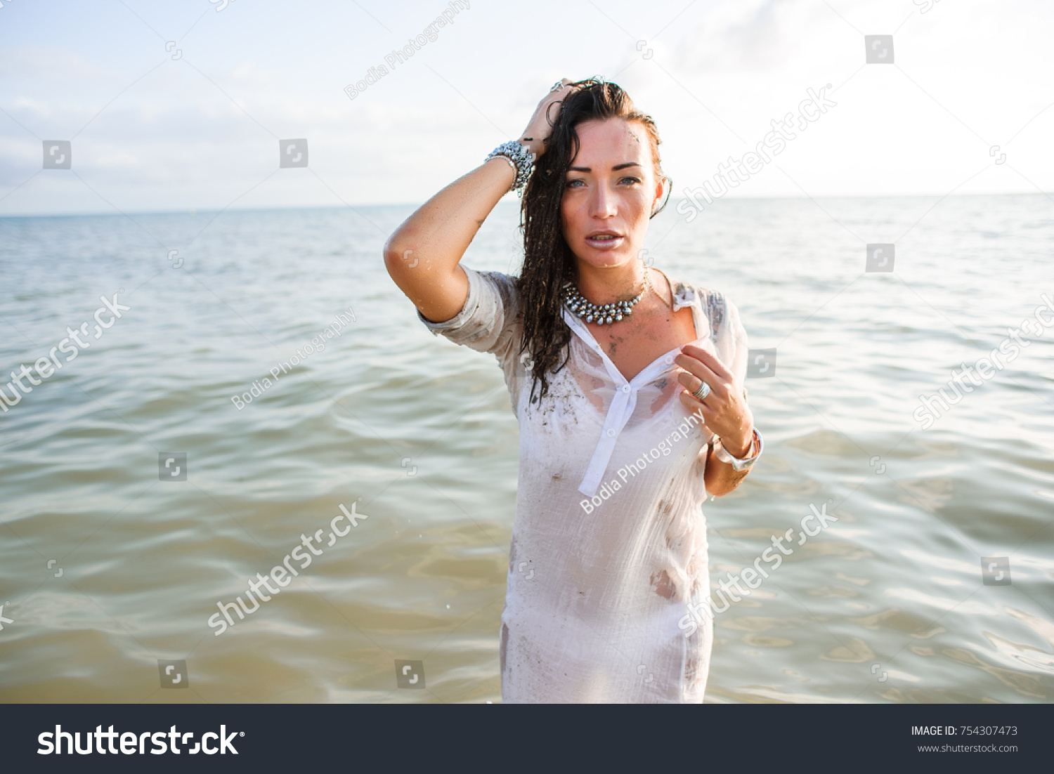 sexy beautiful wet brunette long white stock photo 754307473