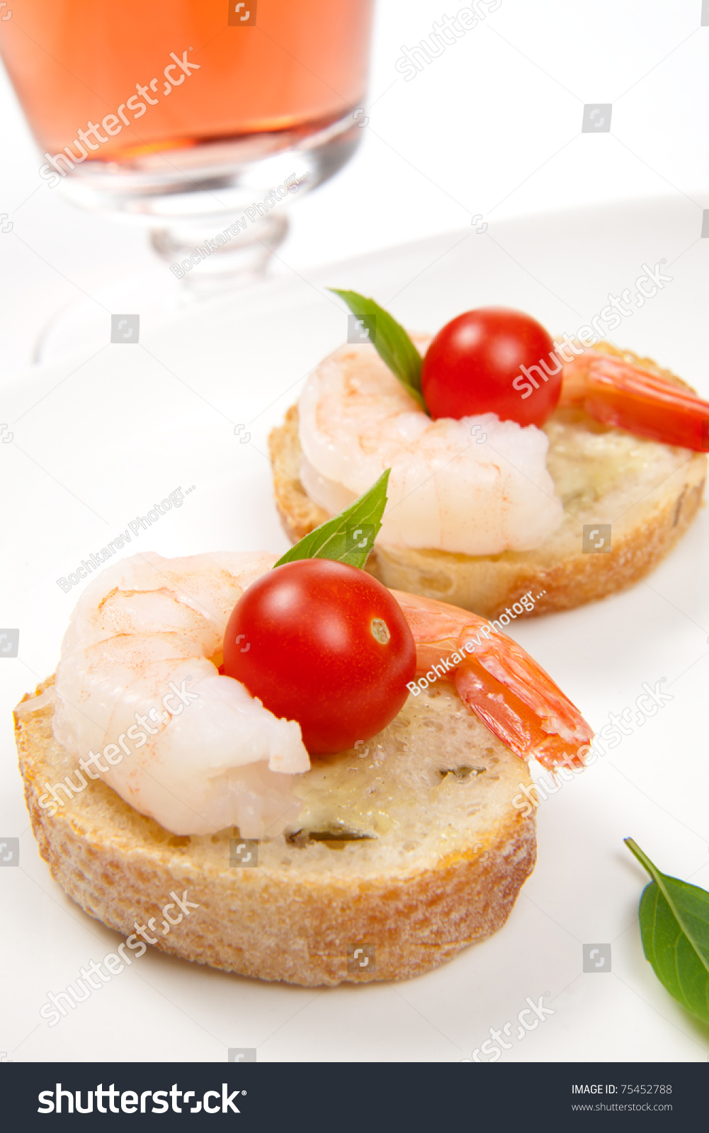 Closeup delicious shrimp canape cherry tomatoes stock for Canape spreaders