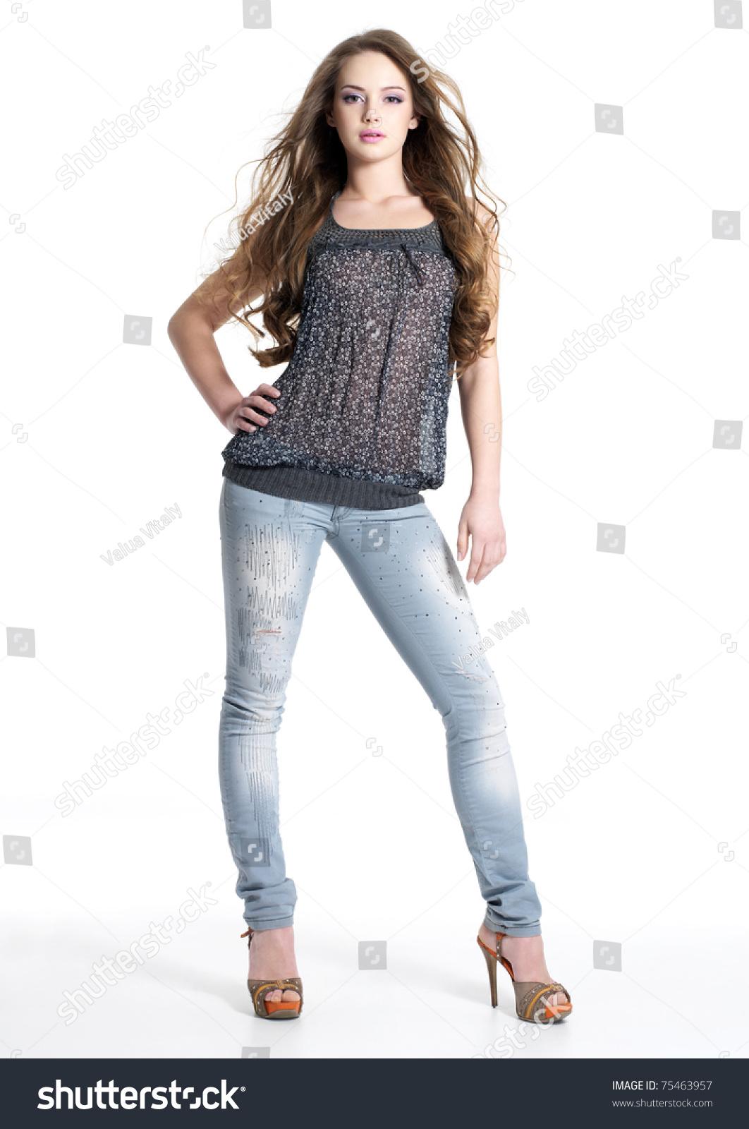 3d25be8238b Full portrait of beautiful stylish girl in fashion stylish jeans posing -  isolated on white background. Fashion model posing at studio.