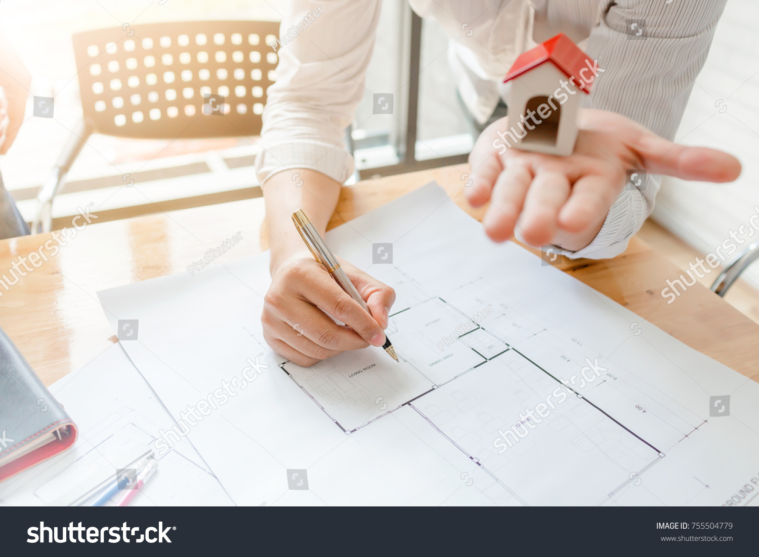 Business architect engineer drawing house blueprint stock photo business architect engineer drawing a house blueprint planning to build a new home at housing estate malvernweather Gallery