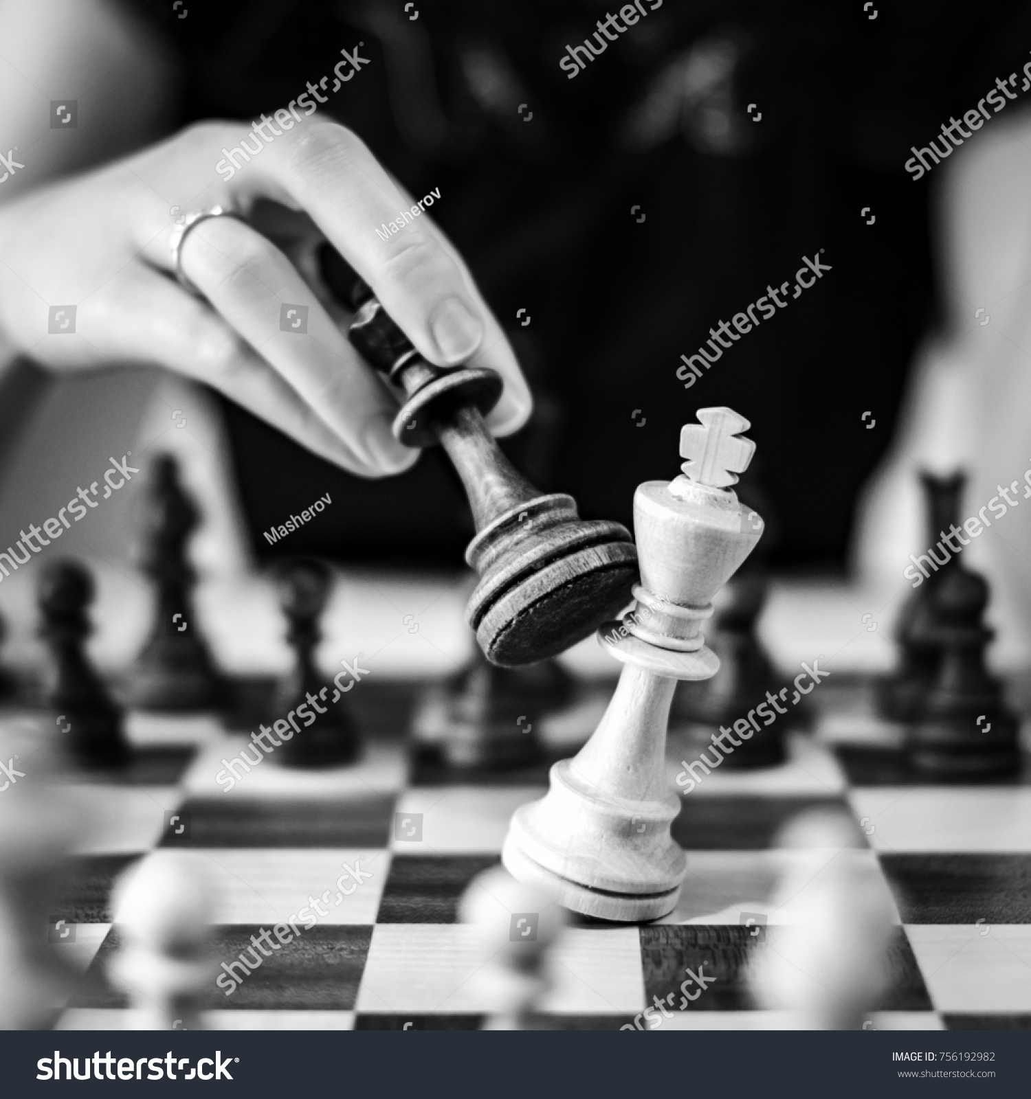Defeating the white king taking the black queen in her hand