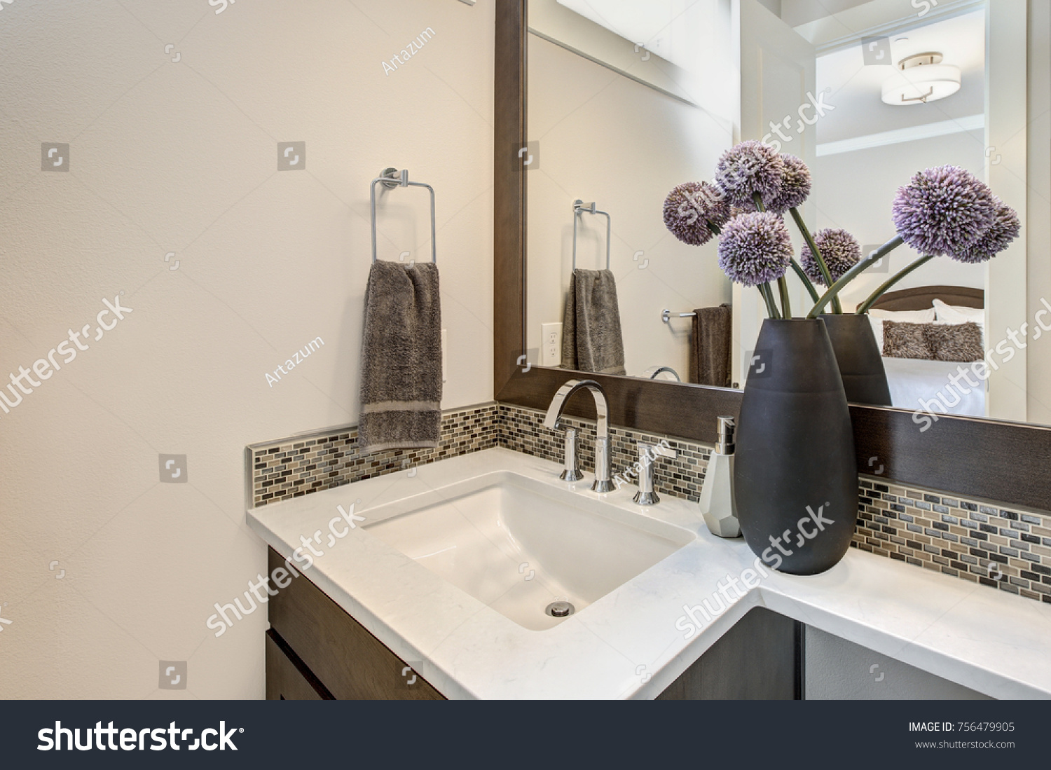 Brown And White Bathroom. White bathroom features a nook filled with brown vanity rectangular  sink and mosaic Bathroom Features Nook Filled Brown Stock Photo 756479905