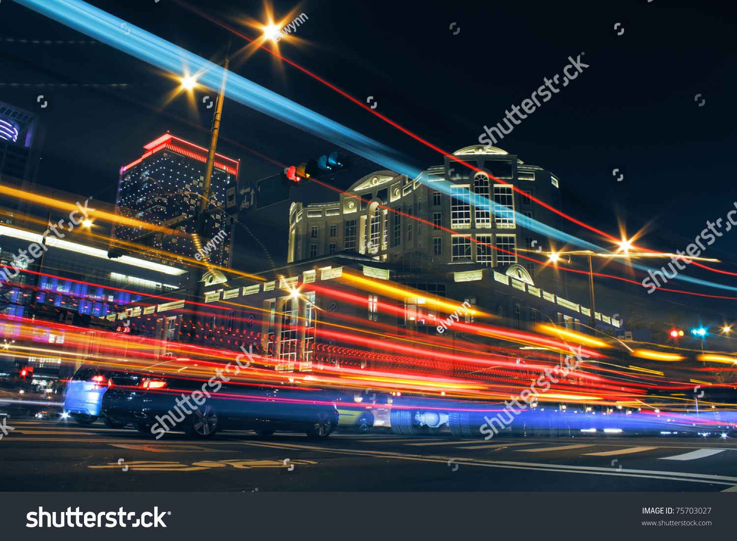colorful city night with lights of cars motion blurred in