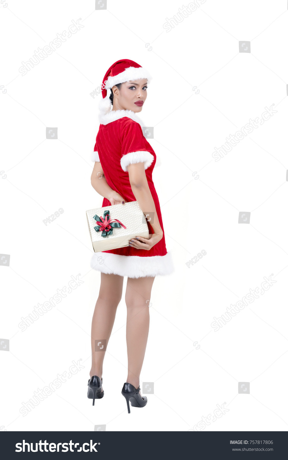 Christmas concept : Beautiful middle-aged Asian woman in Santa Claus ...