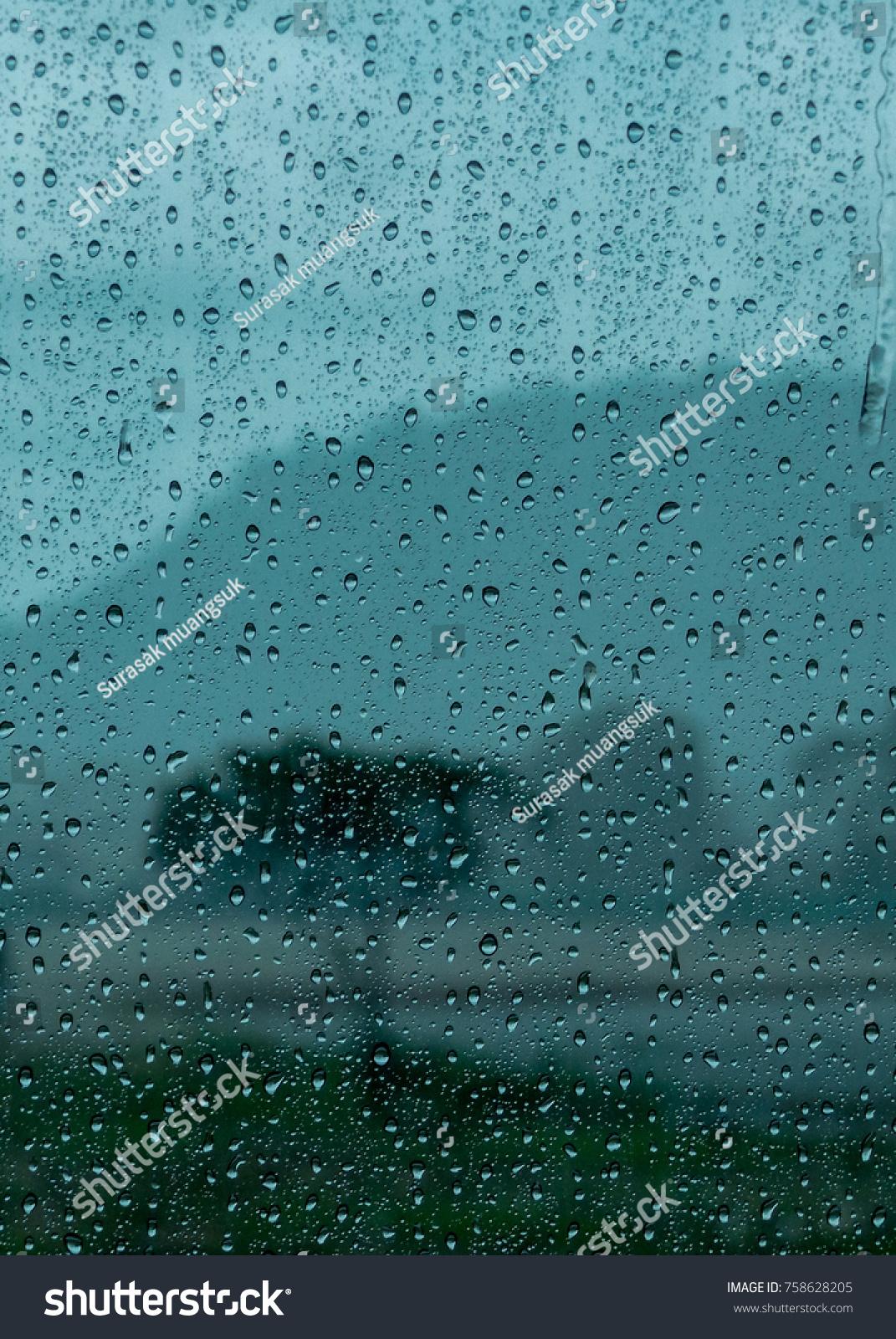 rain water drop of rain on glass window in the rainy season and