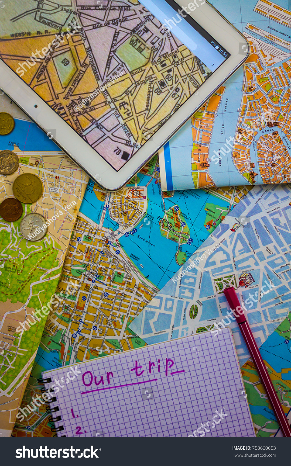 tablet with a map of paris maps of european cities a simple notepad and