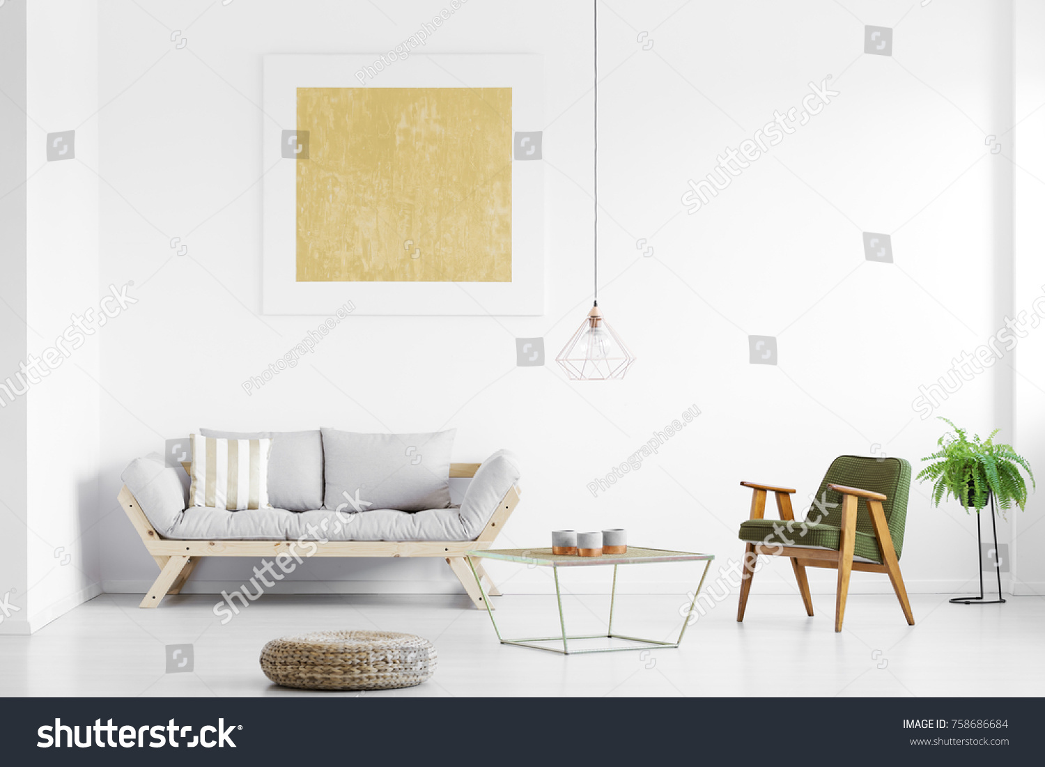 Gold Painting Above Grey Sofa In Bright Living Room With Armchair At Table,  Pouf And