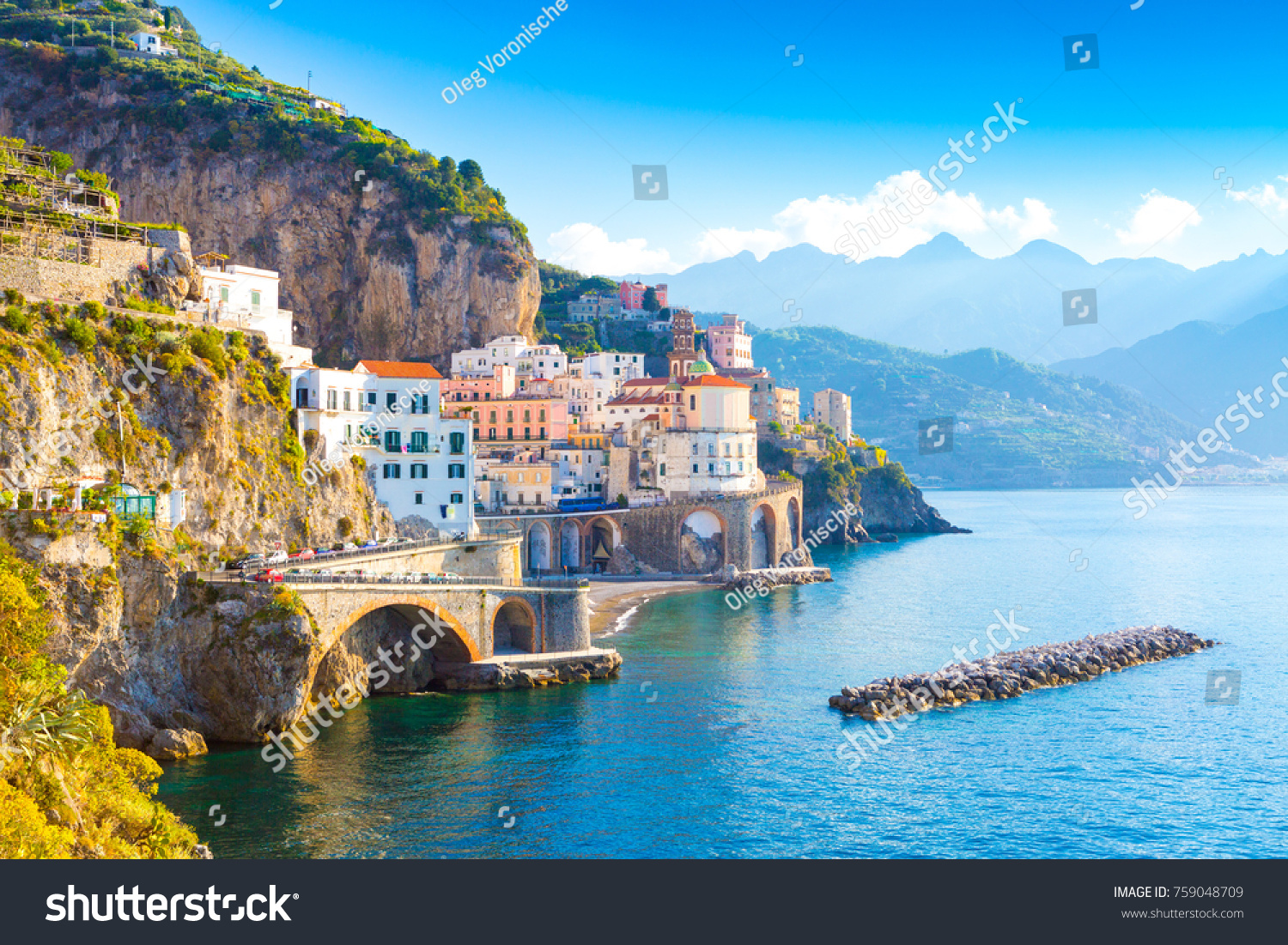 Morning view of Amalfi cityscape on coast line of mediterranean sea, Italy #759048709