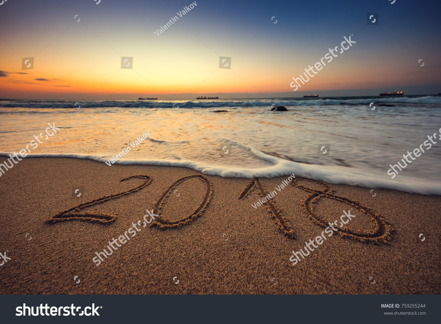happy new year 2018 concept lettering on the beach sea sunrise