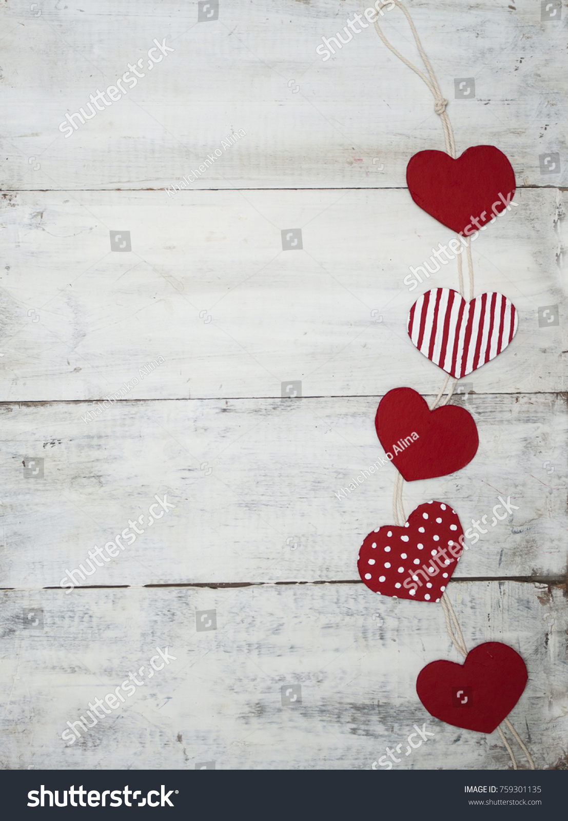 Red Heartshaped Symbols Hanging On Wooden Stock Photo 759301135