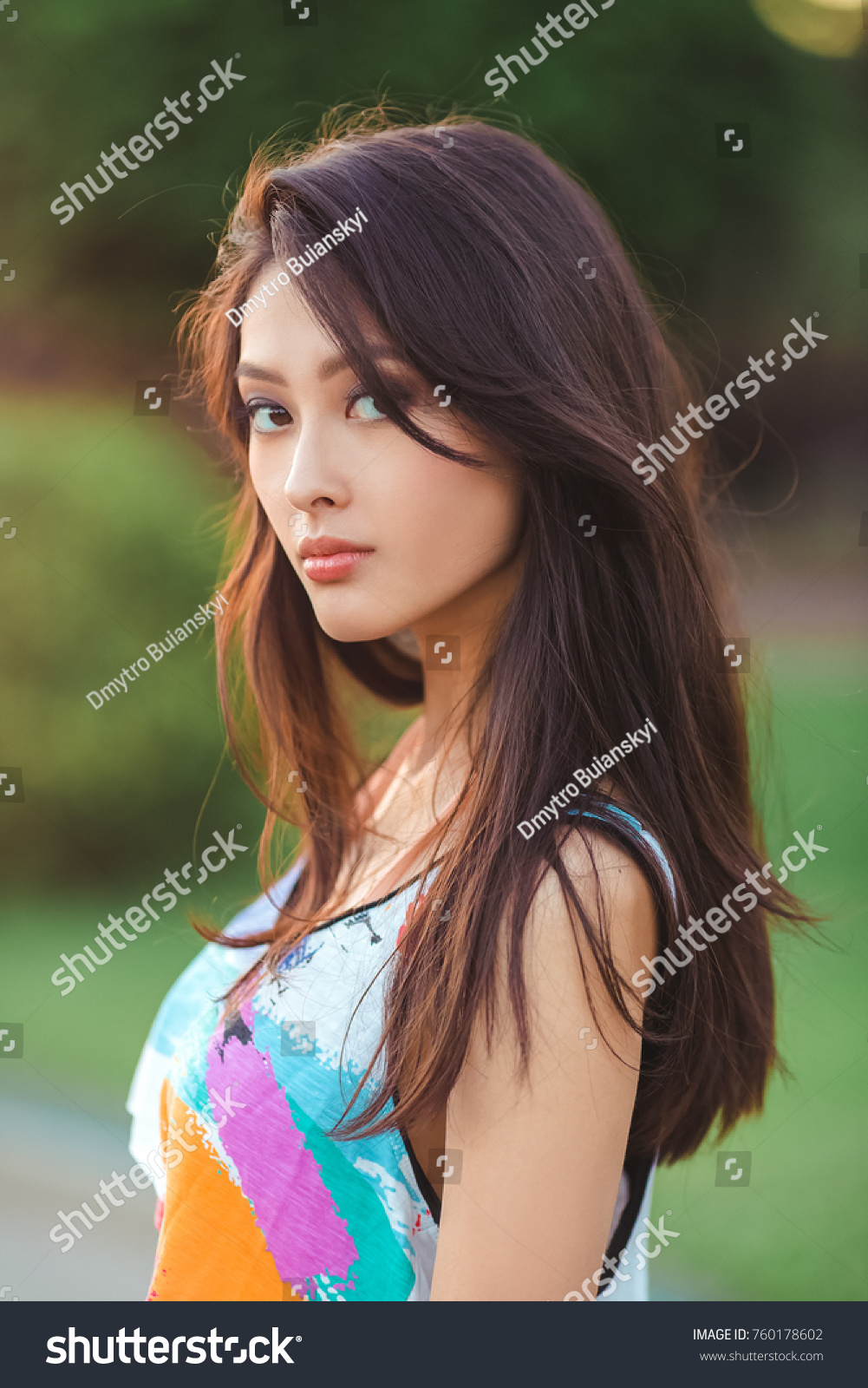 Attractive sporty sexy asian woman in casual clothing standing with in city  park. Sea summer holiday concept portrait. Gorgeous hot model posing near  the ...
