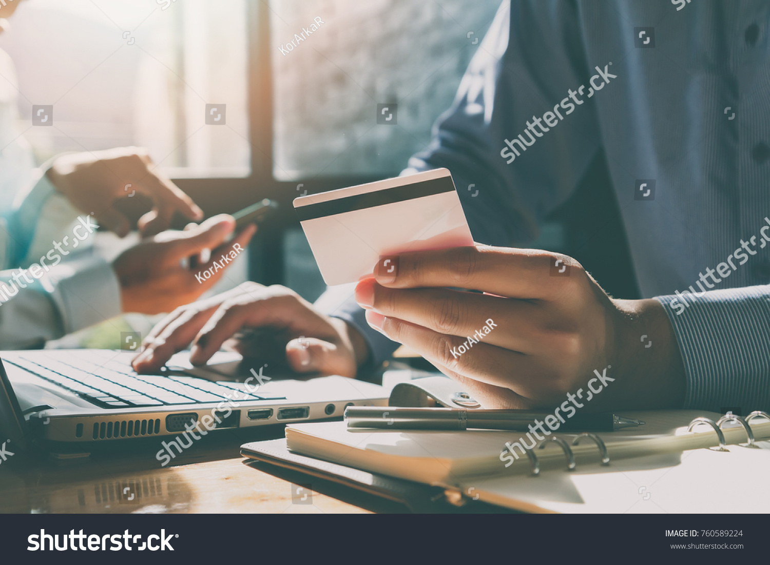 Businessman holding credit card and using laptop. Making payment while online shopping. E-commerce and modern technology concept #760589224