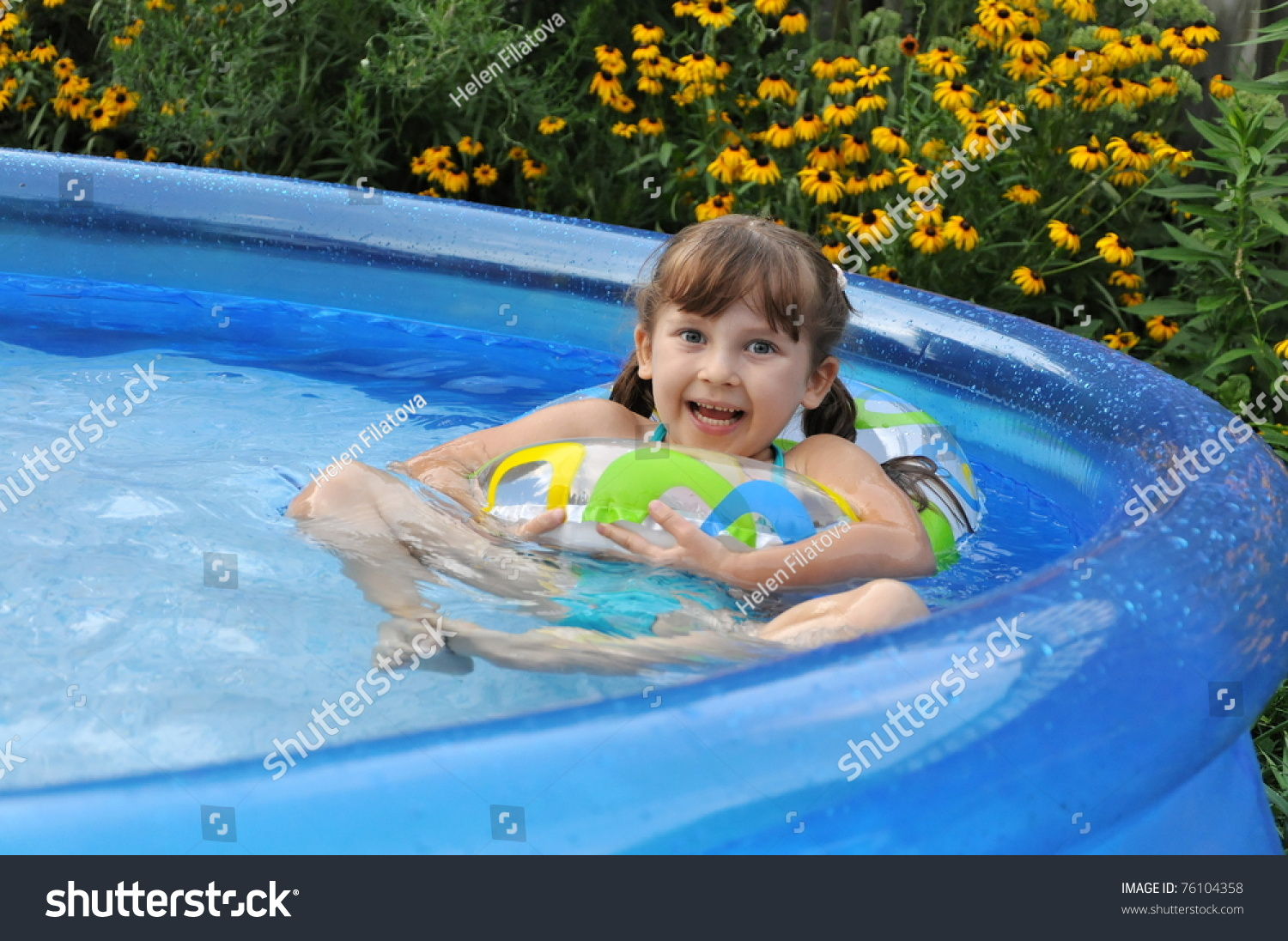 happy swimming pool on backyard stock photo 76104358