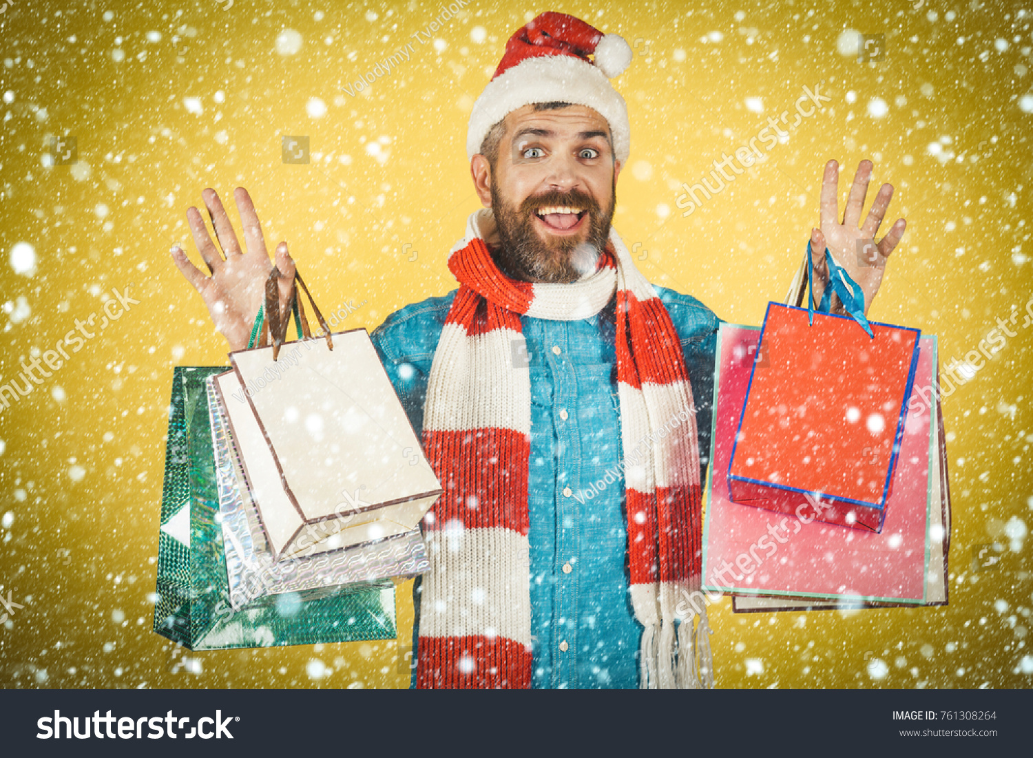 a9056ea37da3a christmas new year snow concept Christmas hipster shopper smile in santa hat  and scarf. Man