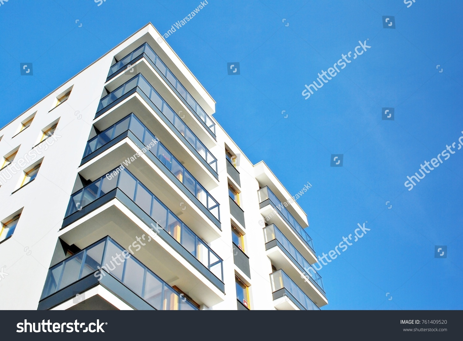 Modern apartment buildings on a sunny day with a blue sky. Facade of a modern apartment building #761409520