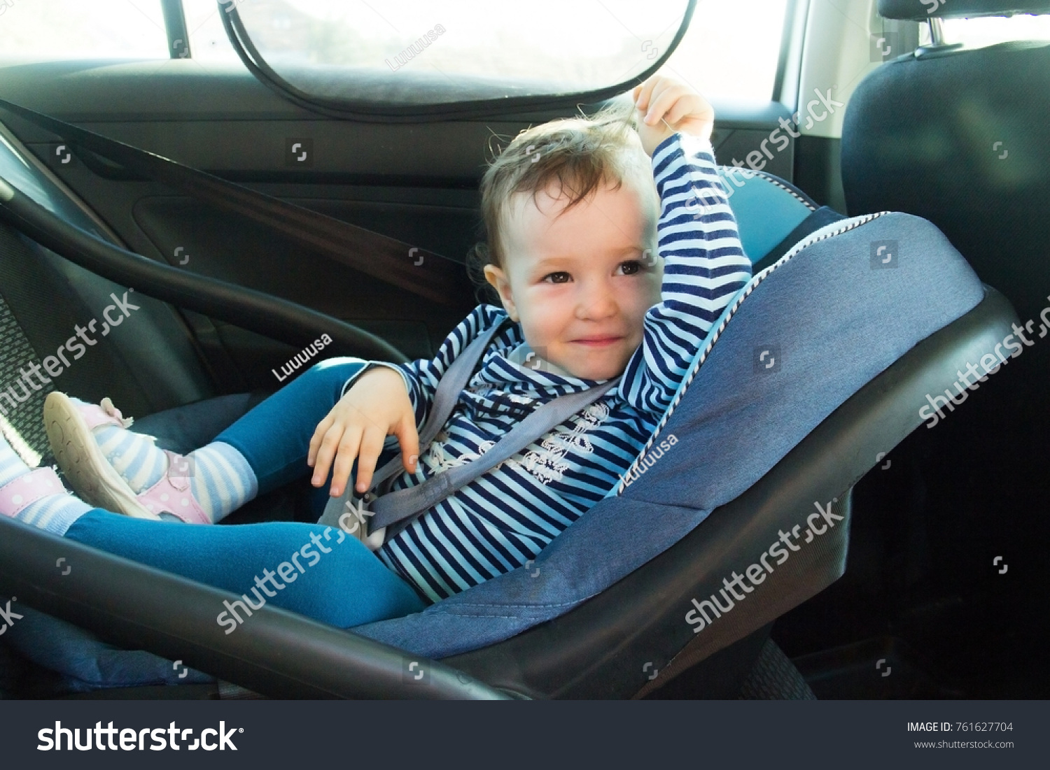 Baby Smile In A Safety Car Seat Safety And Security One Year Old Child